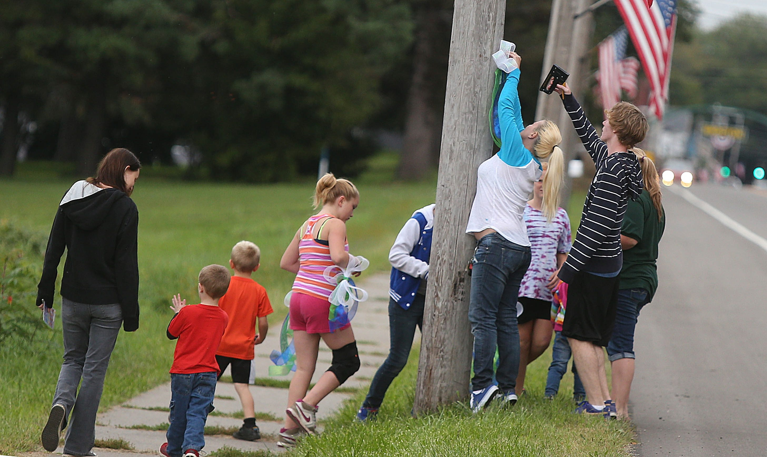 Family and friends staple ribbons to utility poles along Route 20 in the Village of Brocton in honor of Damon W. Janes on Sunday. The football player remains in critical condition in Women & Children's Hospital after being injured Friday.