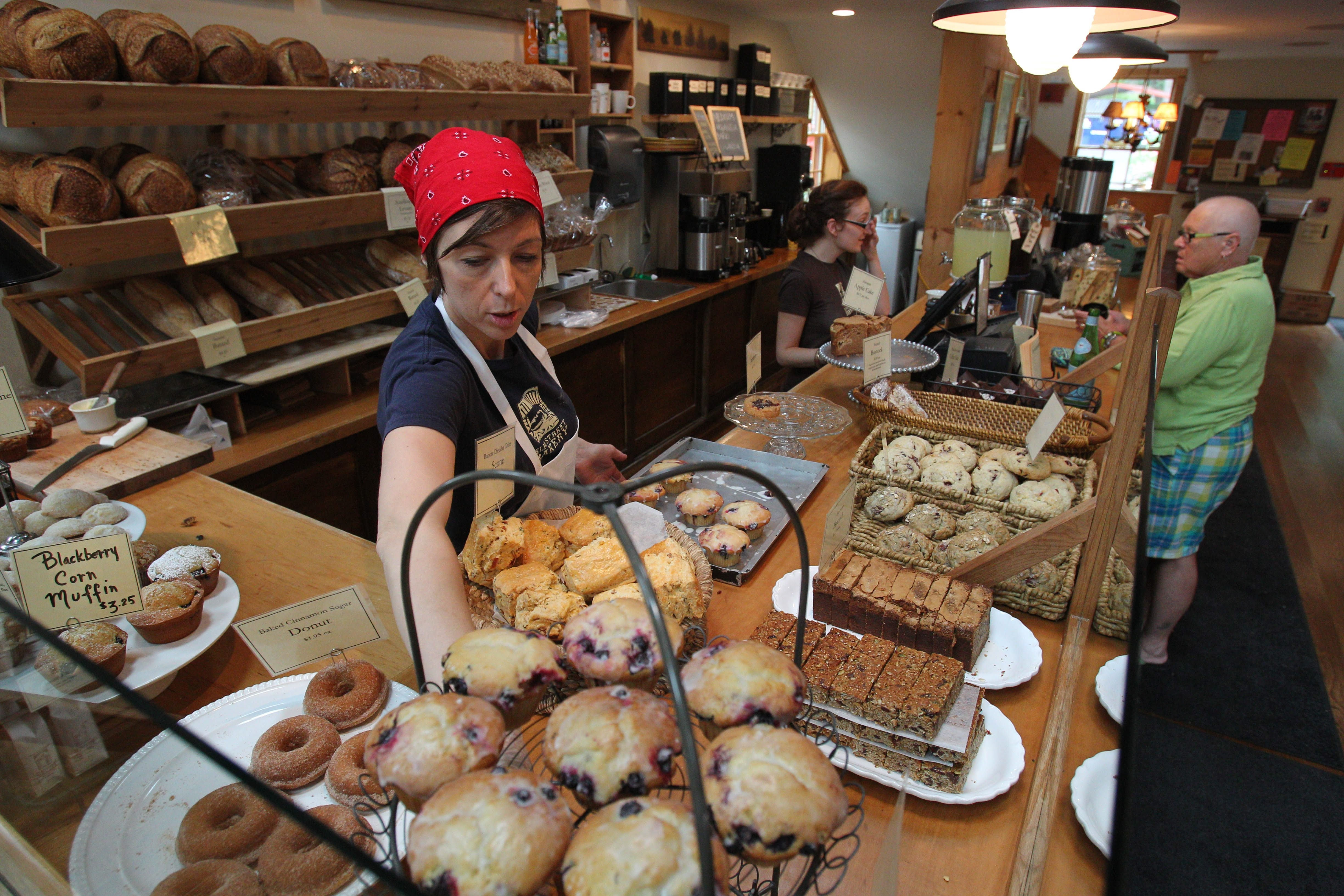 Elm Street in East Aurora is experiencing a renaissance, with the Elm Street Bakery being the anchor.  Luci Levere staffs the pastry, bread and coffee counter in this photo.