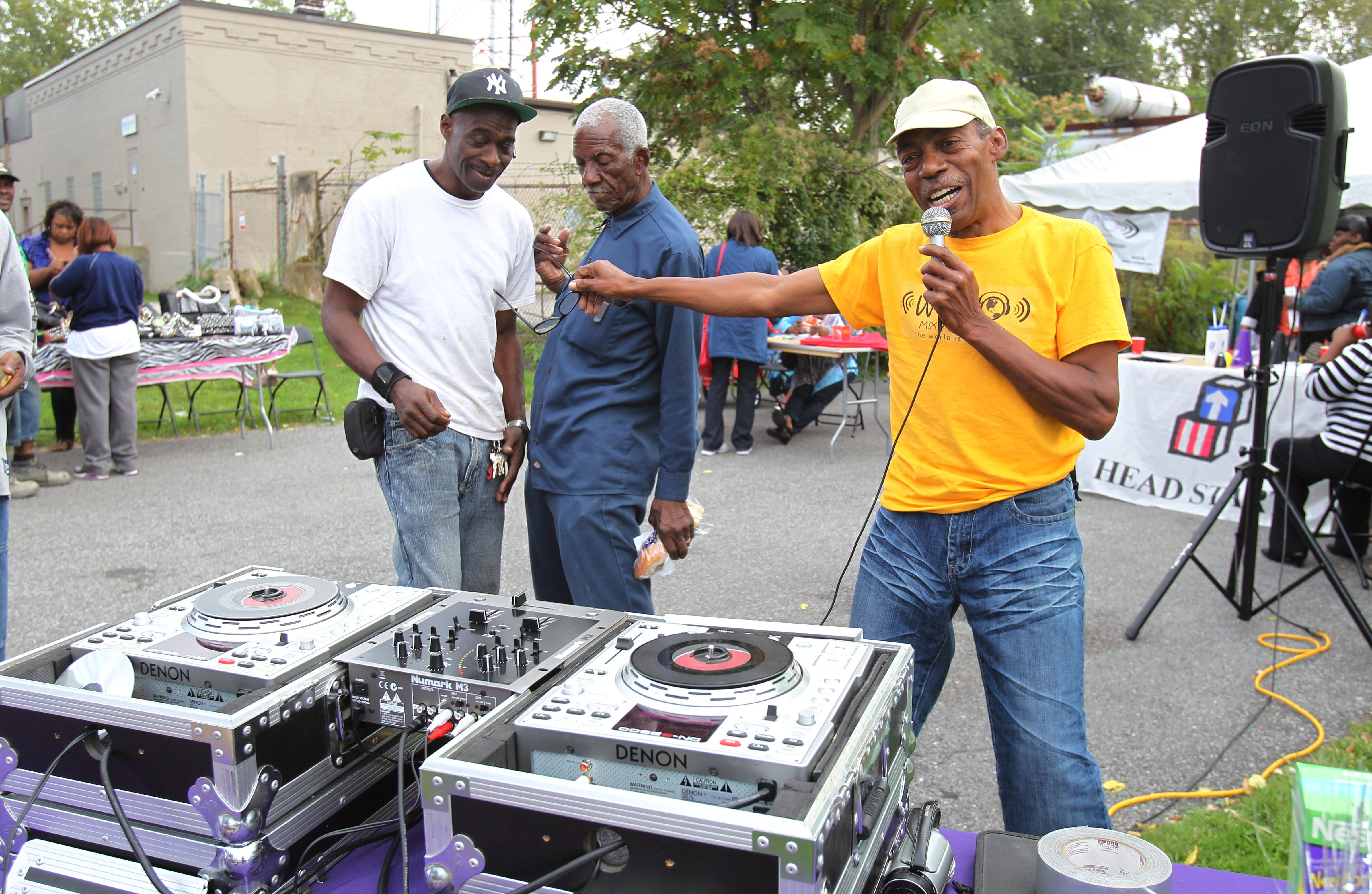 1080 WUFO-AM air personality L.C.H. Roberson deejays Monday's block party outside the station's home on LaSalle Avenue.