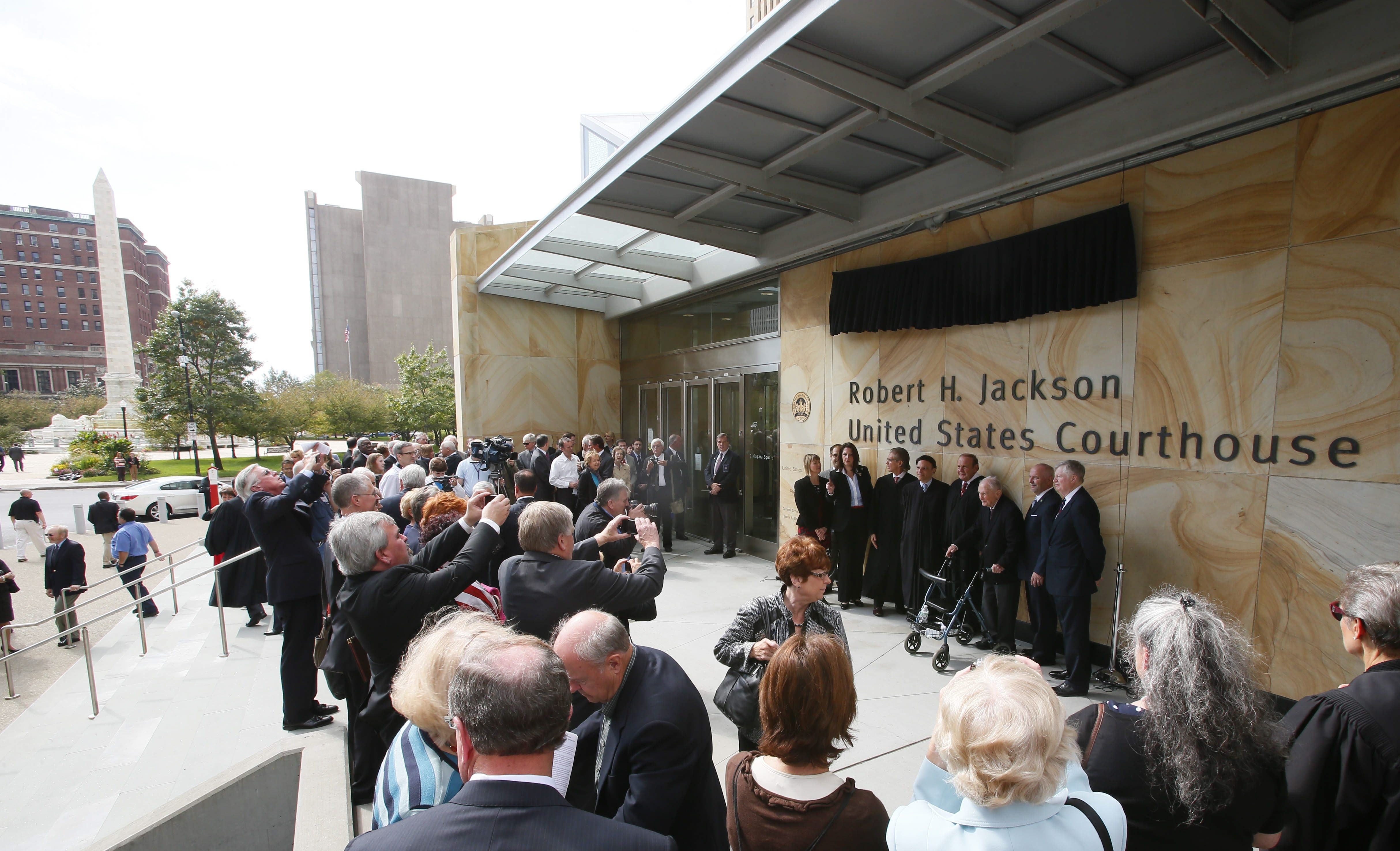 Judges and dignitaries pose for photographs during a ceremony to officially name the Robert H. Jackson United States Courthouse in Niagara Square.
