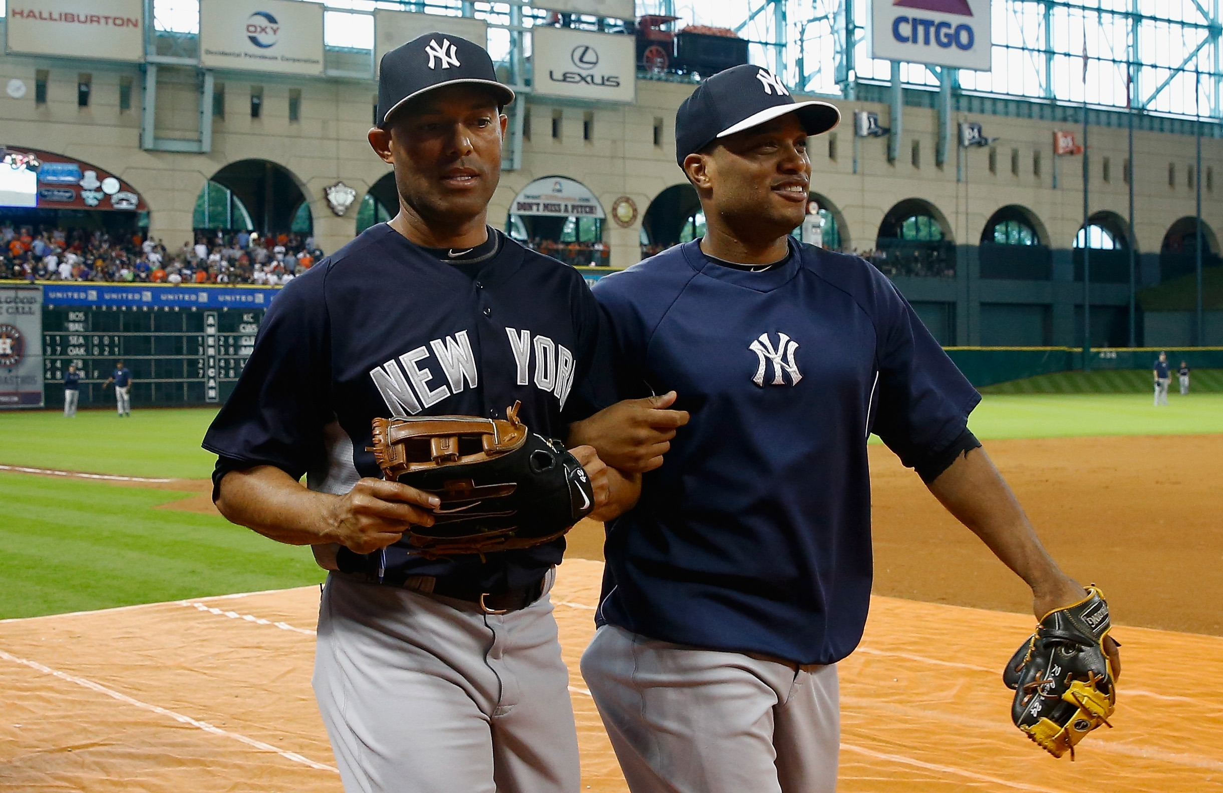Mariano Rivera, left, is leaving for sure but Robinson Cano, right, could follow him out the door in the Bronx as a high-priced free agent.