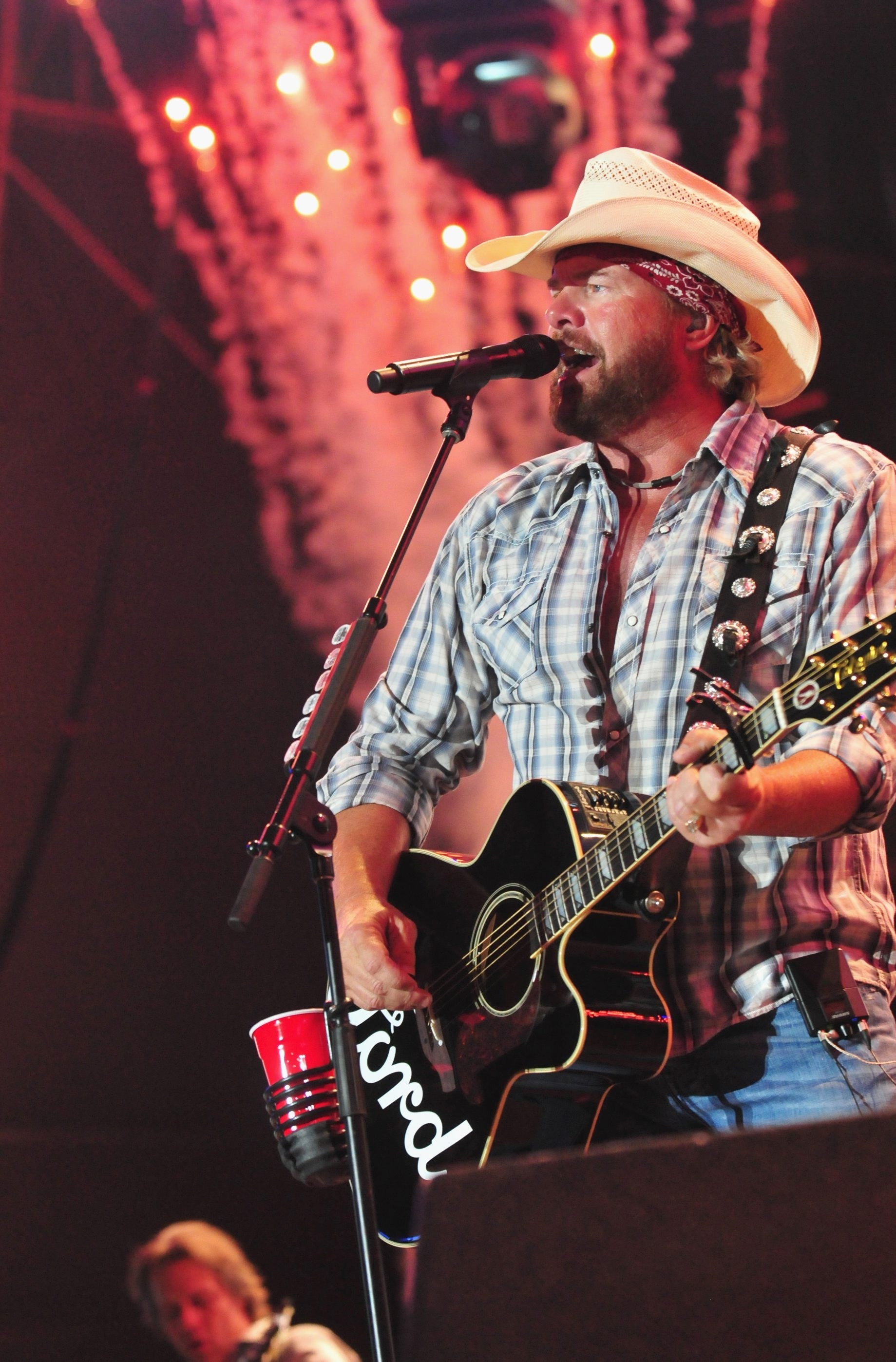 Toby Keith performs during the Oklahoma Twister Relief Concert at Gaylord Family Oklahoma Memorial Stadium in July in Norman, Okla.