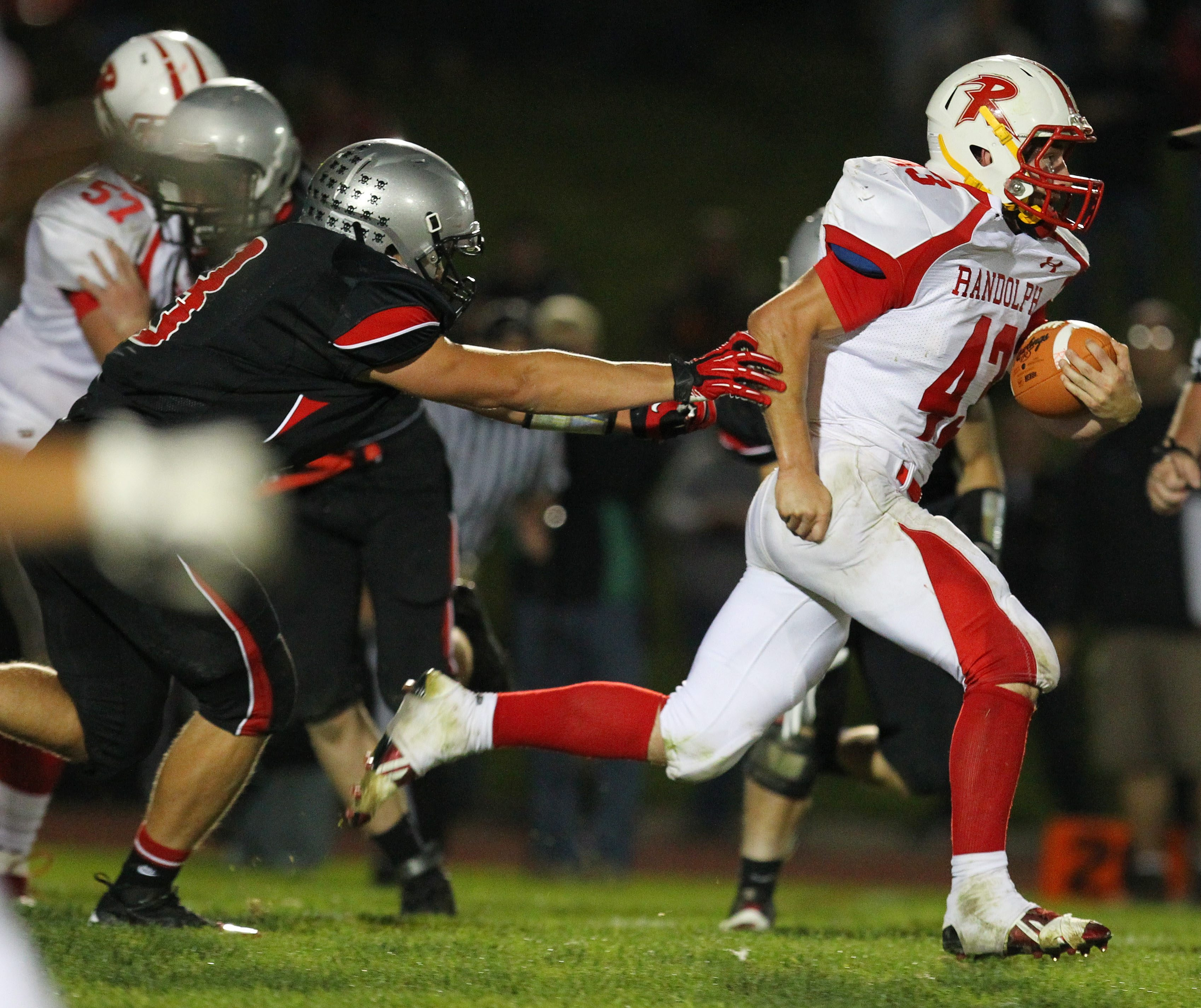 Randolph's Chris Doubek bursts through the Maple Grove/Chautauqua Lake line for one of his many big gainers during Friday's Class D game. Doubek finished with 337 yards in the 35-7 win.