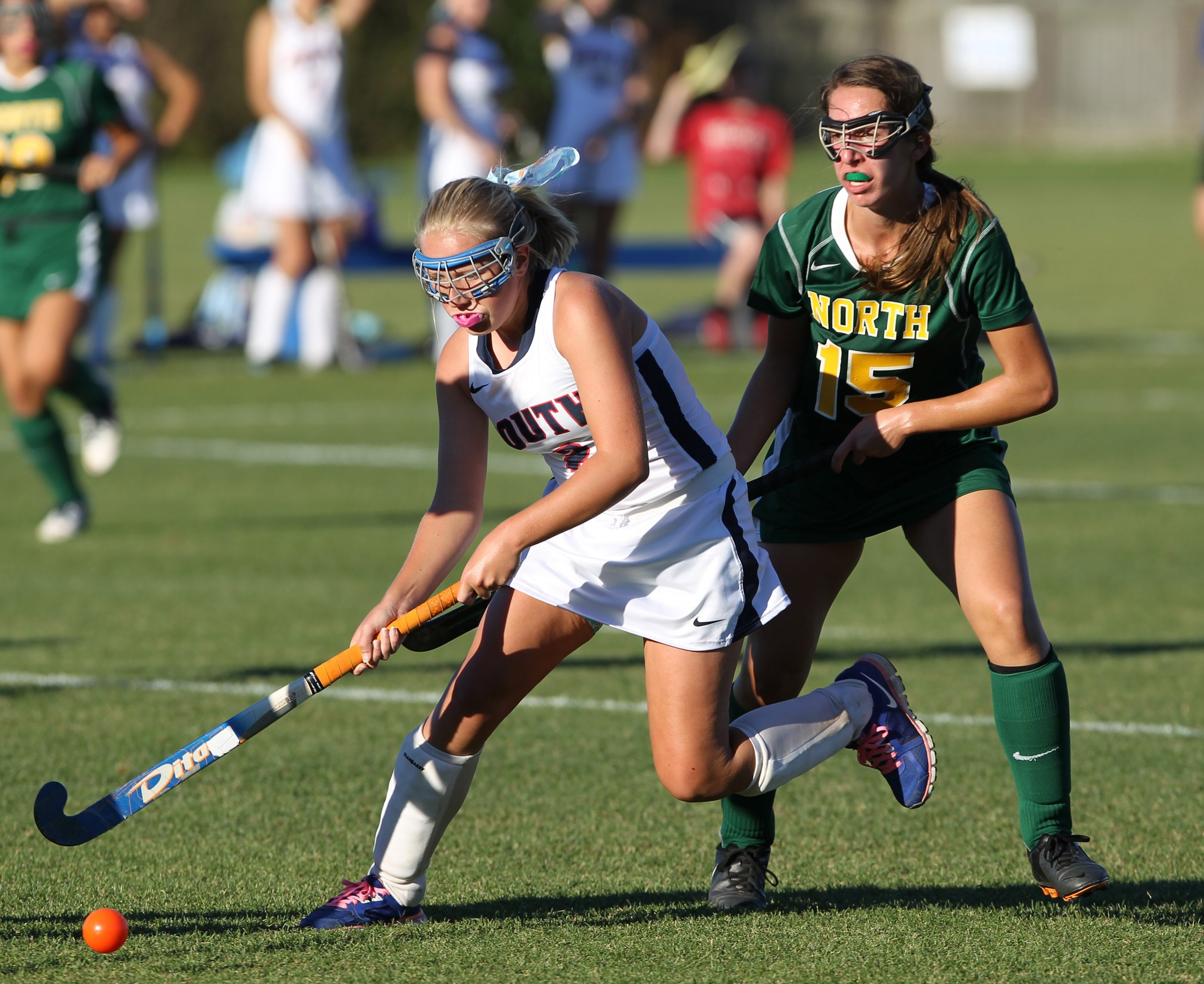 Williamsville South's Abby Ferenczy battles Williamsville North's Gina Battaglia (15) for the ball in the second half of the Billies, 1-0, win in ECIC field hockey.