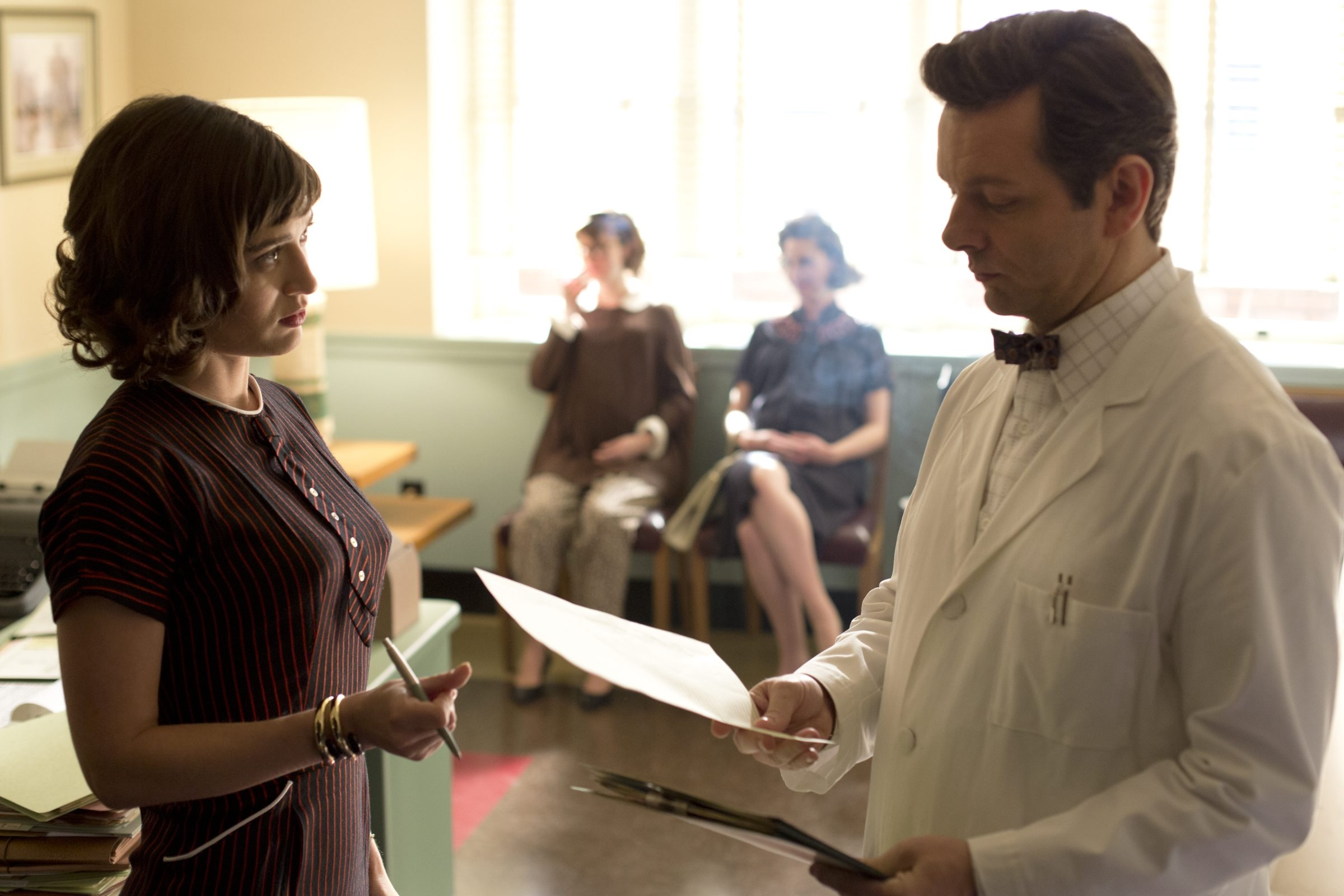 """Michael Sheen as Dr. William Masters and Lizzy Caplan as Virginia Johnson in """"Masters of Sex"""" airing on Showtime."""