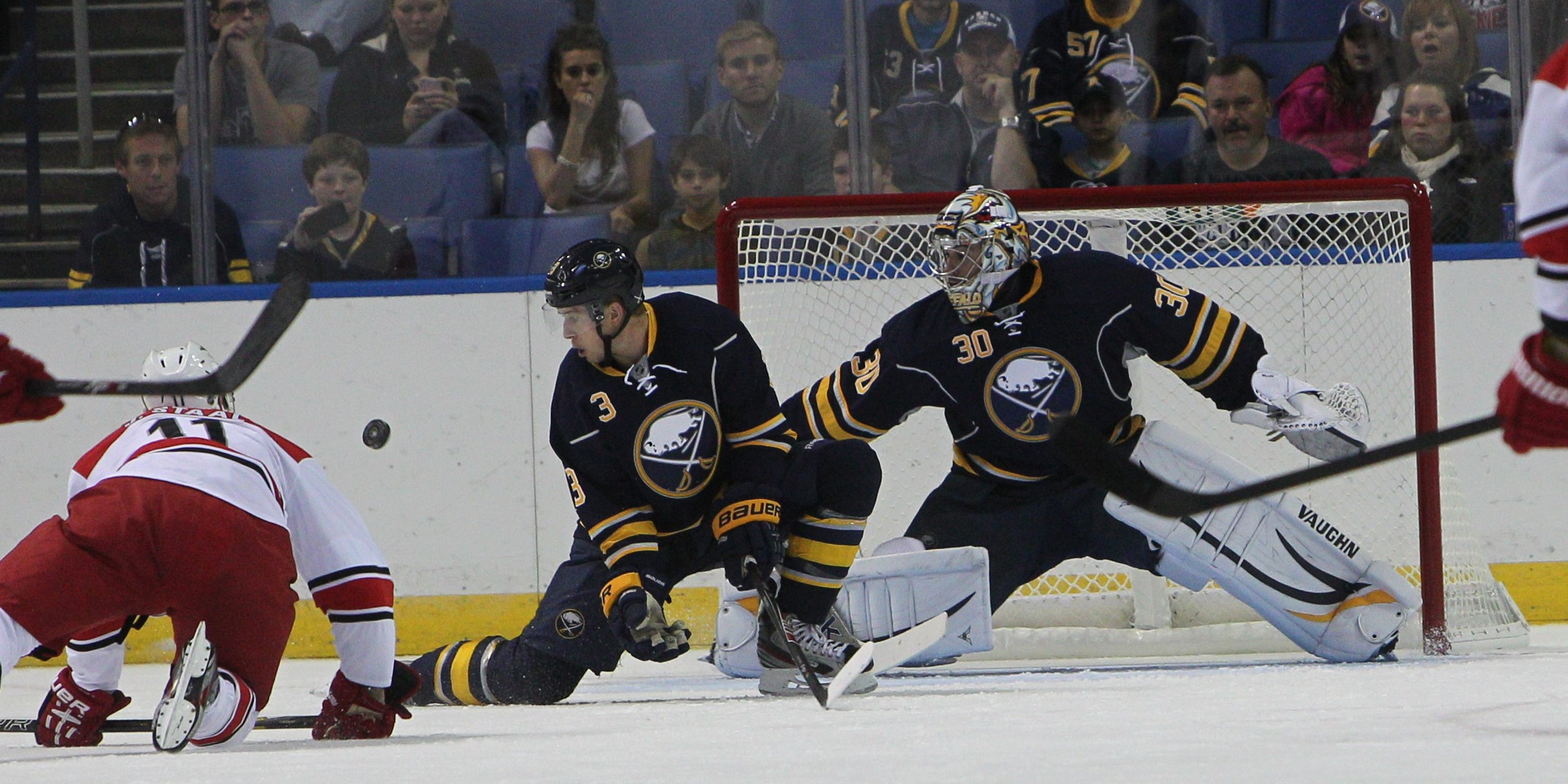 Buffalo's Mark Pysyk (3) could turn out to be the best friend of Sabre goalies like Ryan Miller (30) this season.