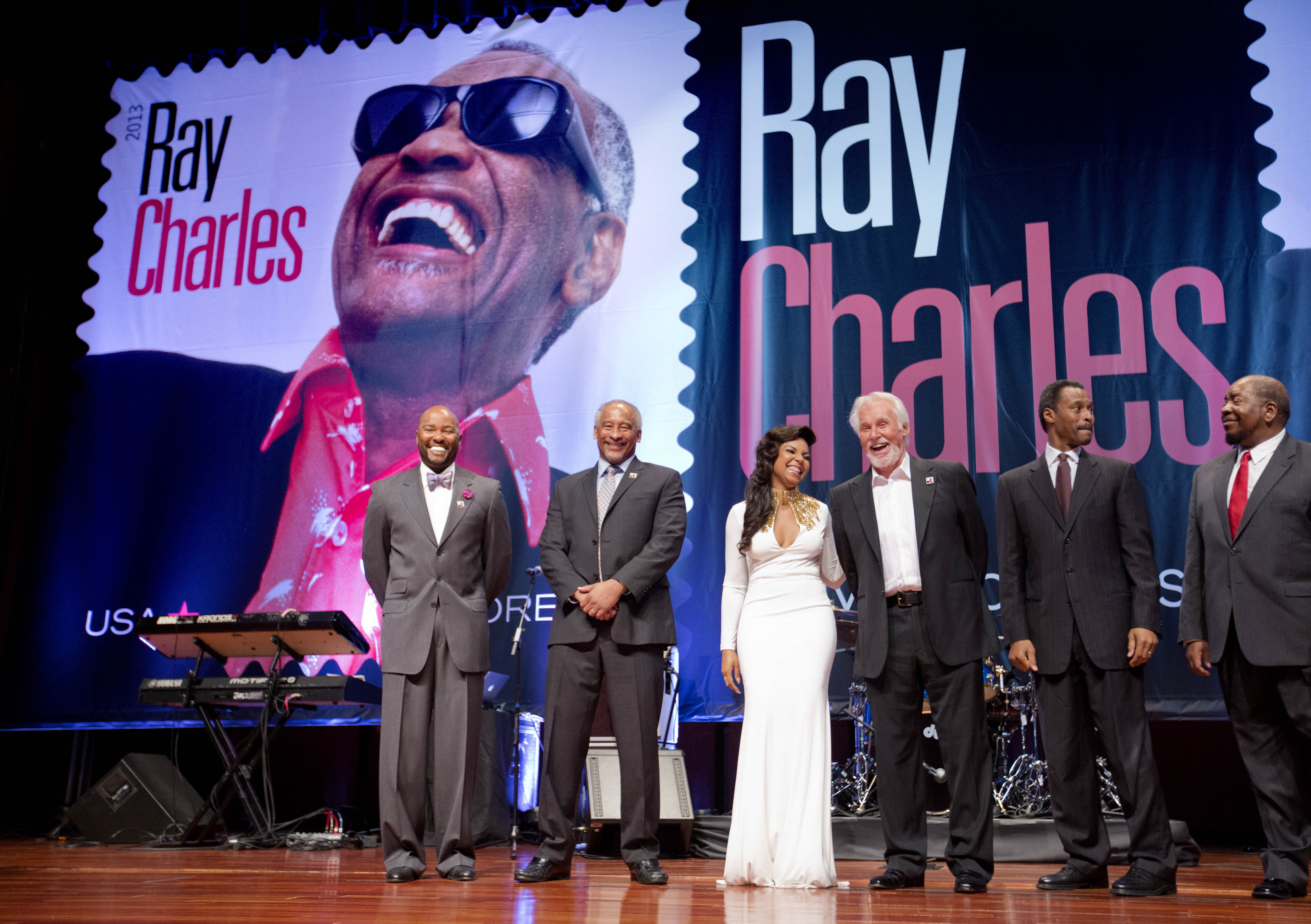 """Postal Service officials unveiled a new stamp featuring musician Ray Charles at Morehouse College in Atlanta on Monday. It is part of the """"Music Icons Forever"""" series."""