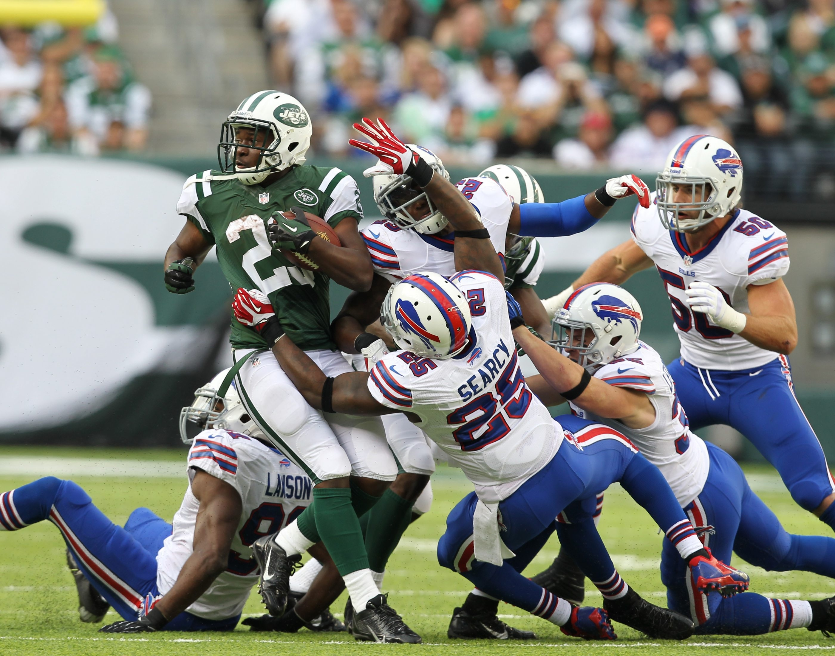 Jets running back Bilal Powell (29) runs over the Bills defense in first half play on Sunday.