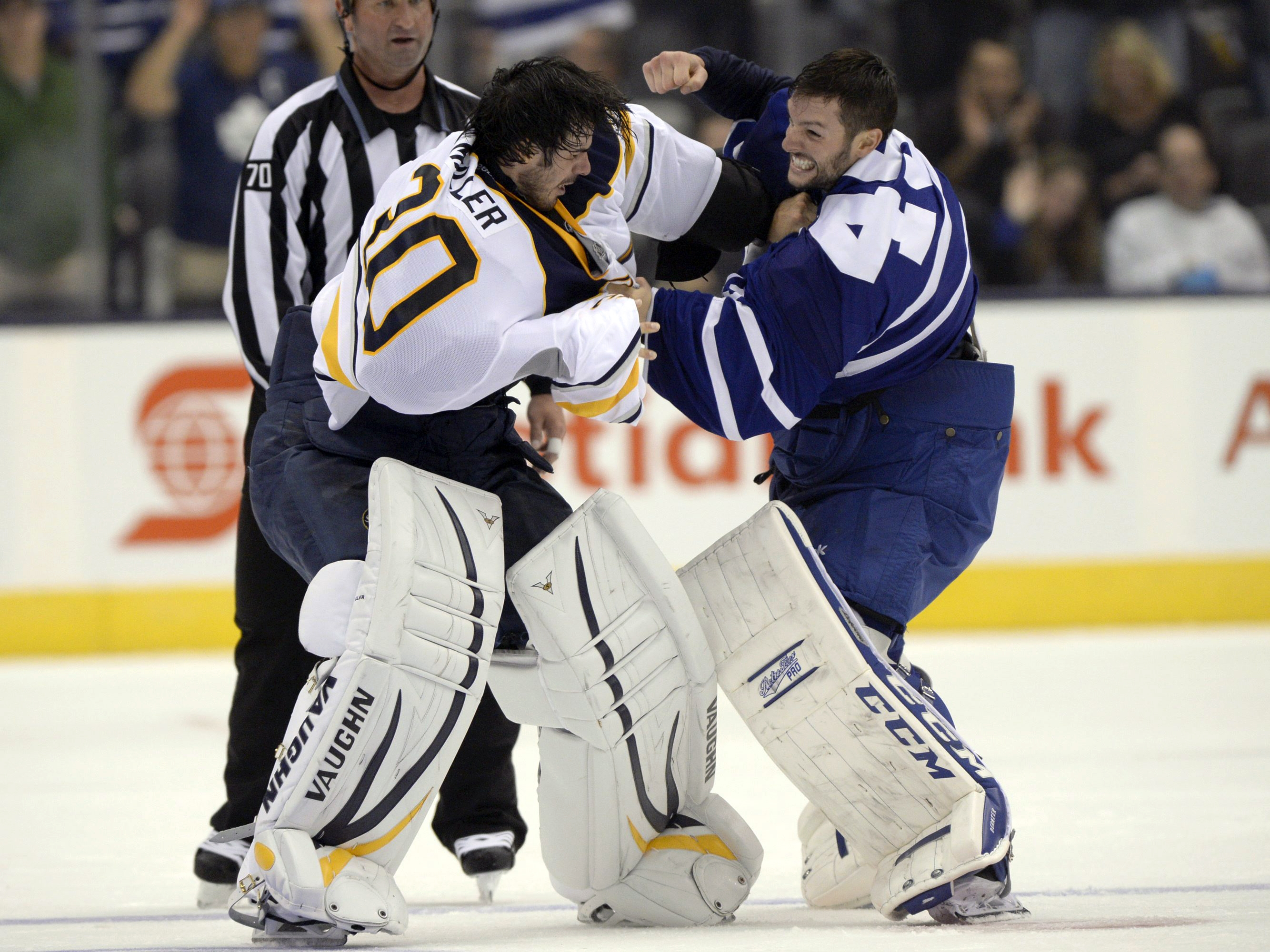 Buffalo Sabres goalie Ryan Miller fights with Toronto Maple Leafs goalie Jonathan Bernier during the third perio. (AP Photo/The Canadian Press, Frank Gunn)