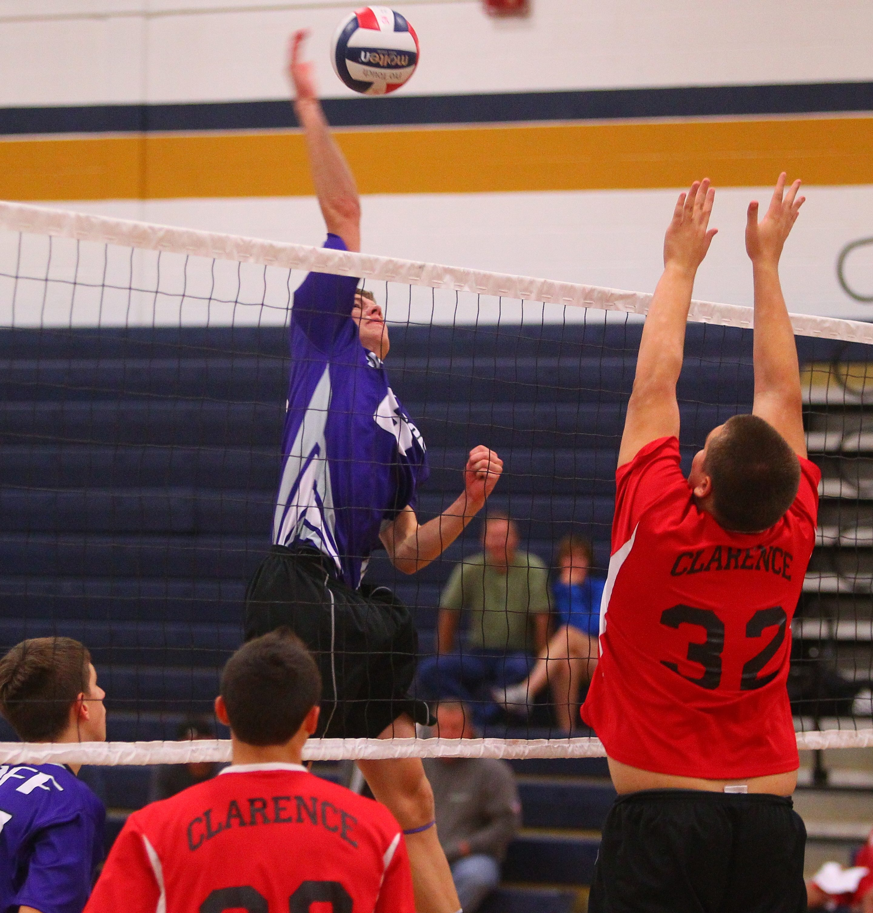Hamburg senior Patrick Stroh (left) was named MVP at Saturday's Sweet Home Volleyball Tournament as the Bulldogs beat Clarence in the final.