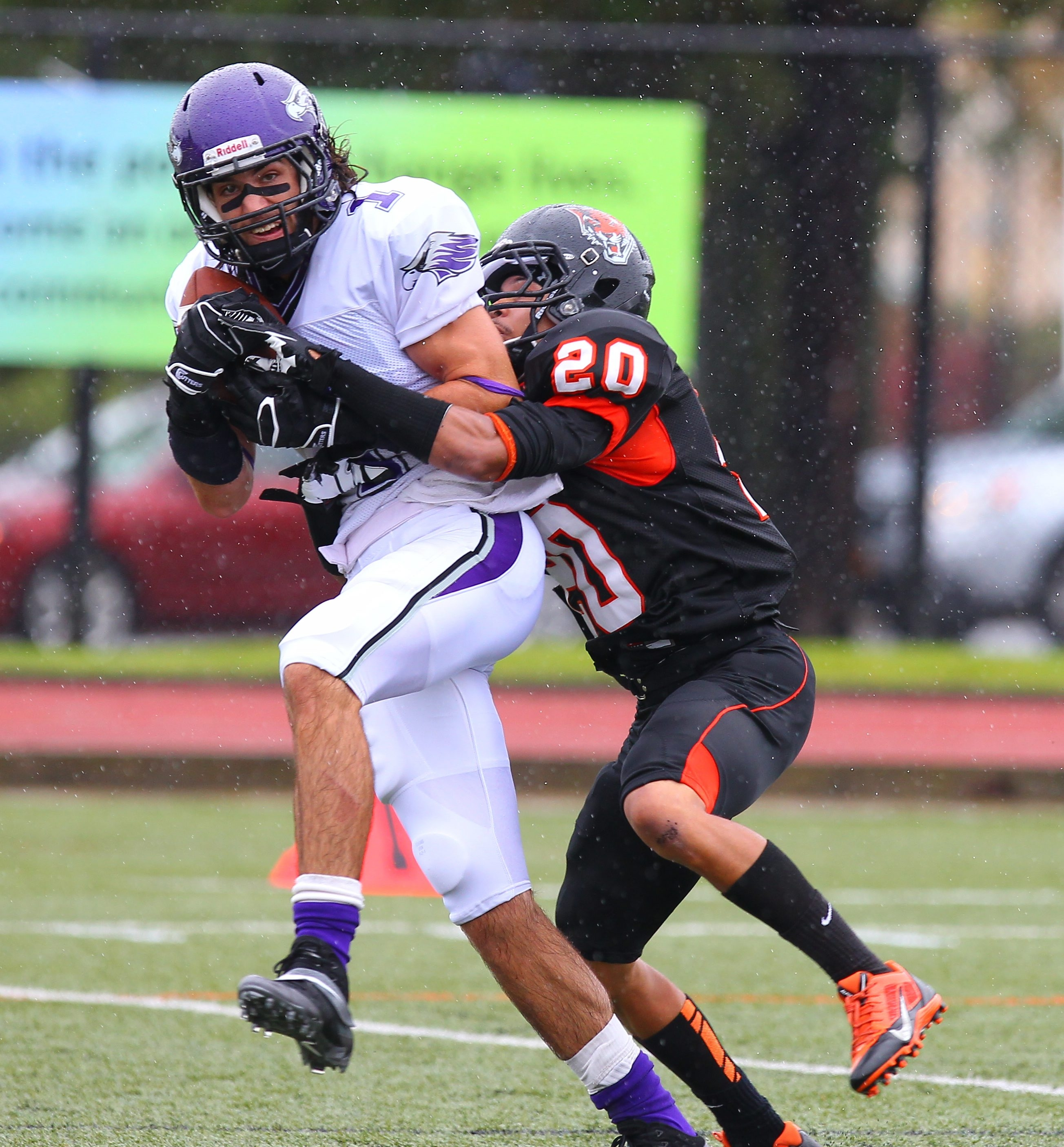 Buffalo State's Chris Hall (20) tackles  Wisconsin-Whitewater   receiver Jake Kumerow.