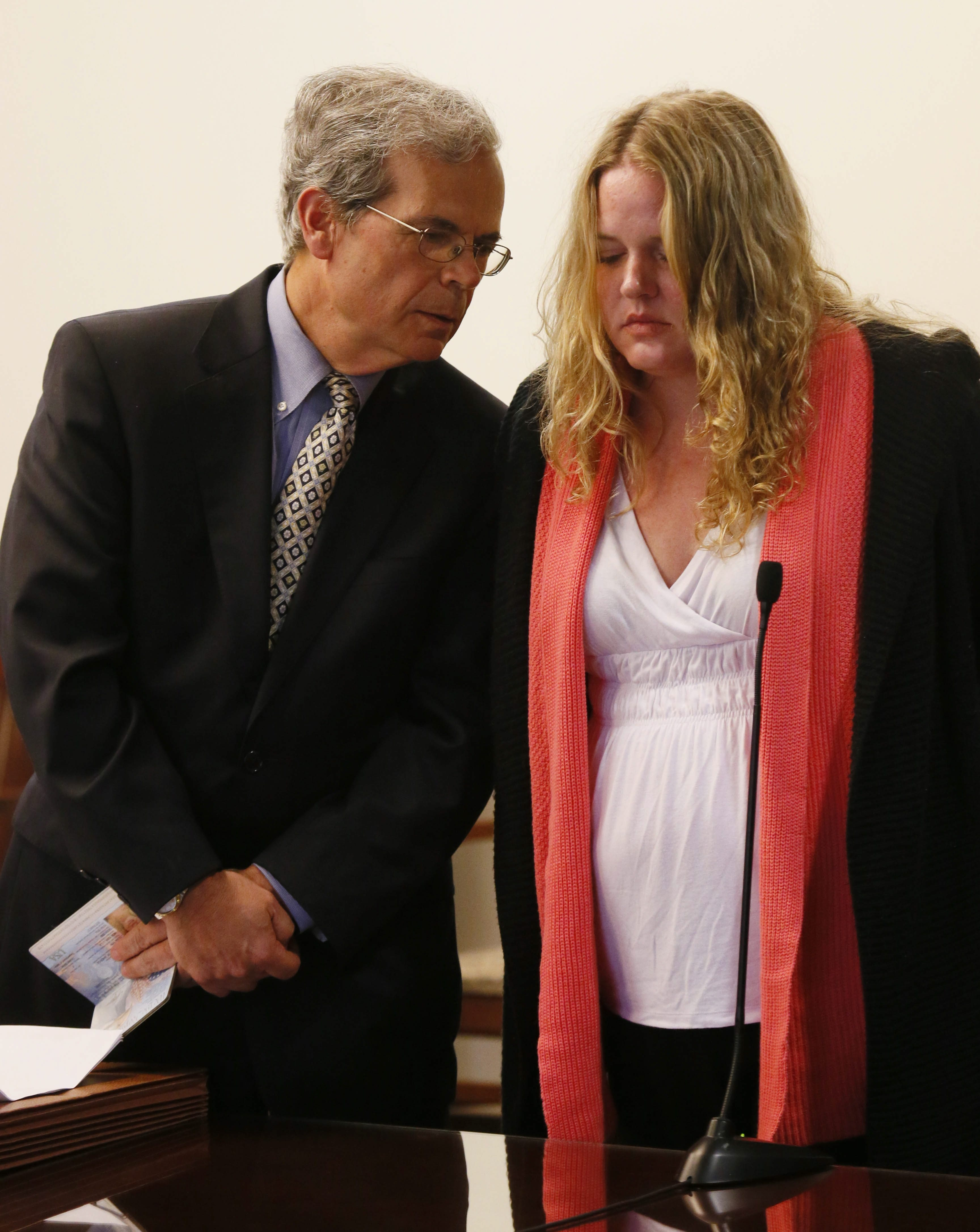 With defense attorney John Nuchereno at her side, Candace Cartagena is shown at her arraignment on charges that she murdered her 8-year-old daughter, Bianca, in November 2010.