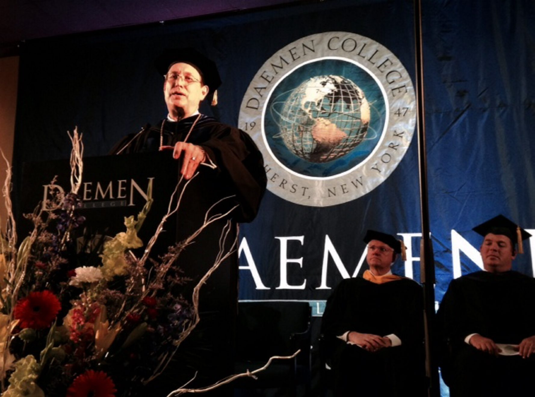 Gary Olson speaks Friday after his inauguration as the sixth president of Daemen College in Snyder.
