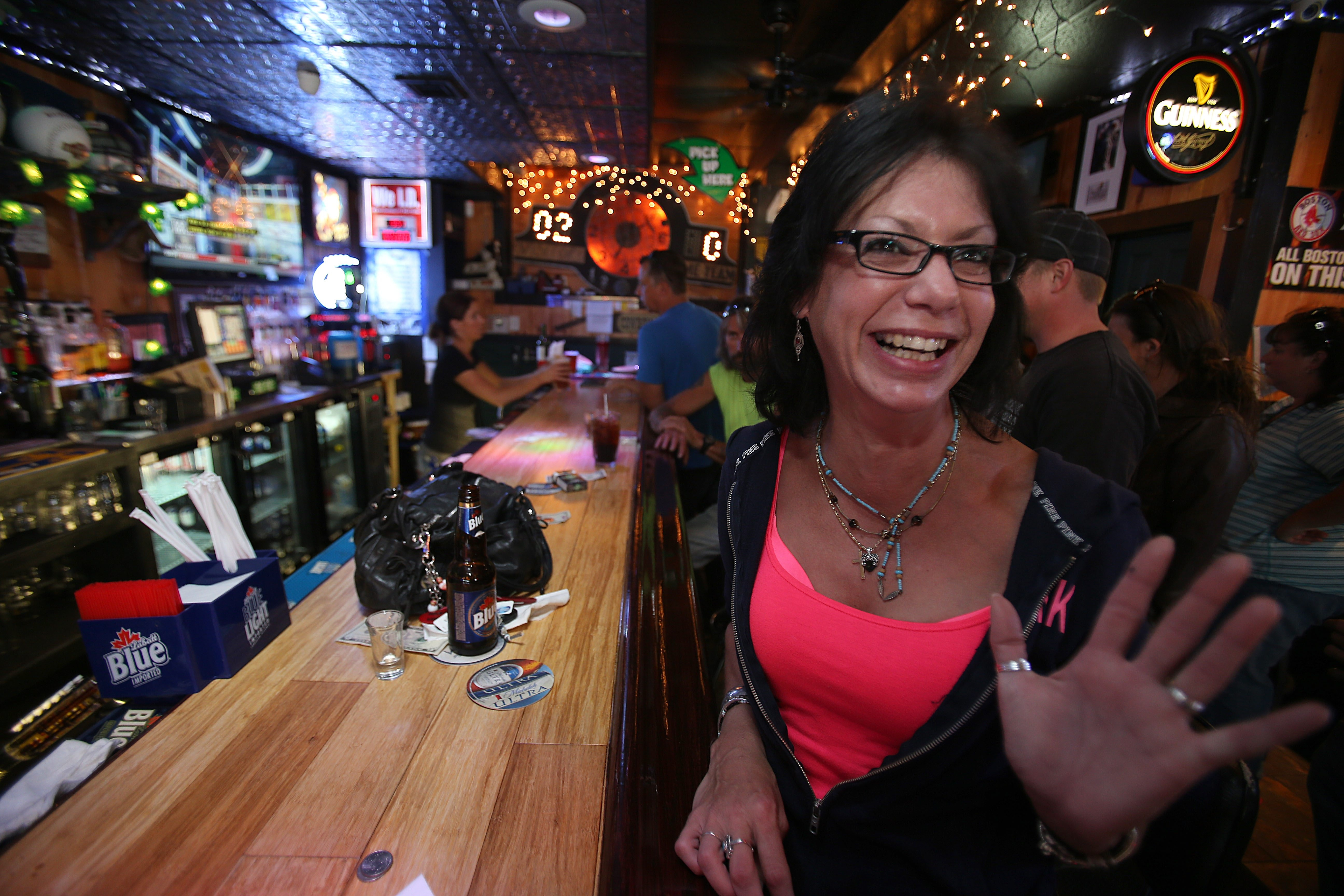 Christine Larosa, of Depew, has a laugh at Mooney's Sports Bar & Grill on Broadway in Depew.