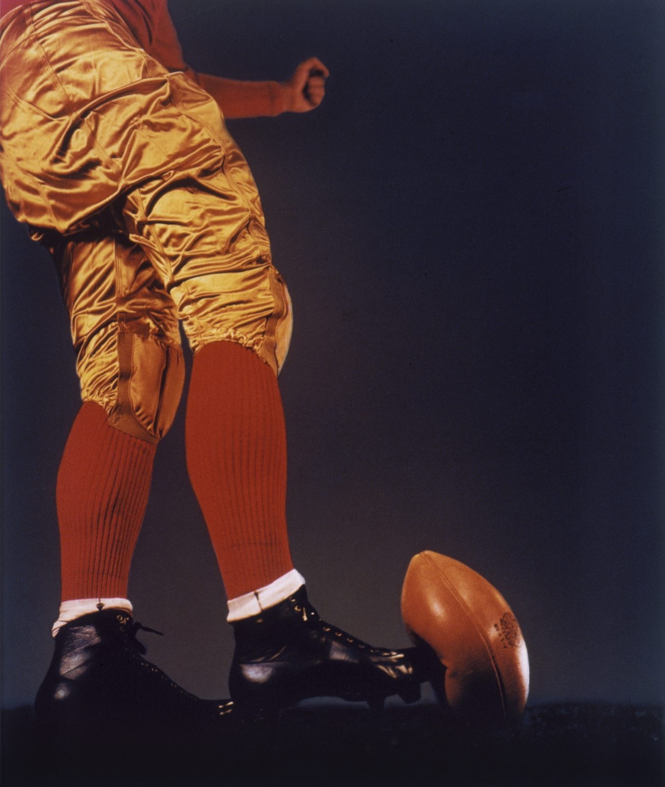 """A black and white version of """"Football Kick,"""" a 1938 photograph by Harold Edgerton, is on view in """"The Art of Sport"""" in CEPA Gallery."""