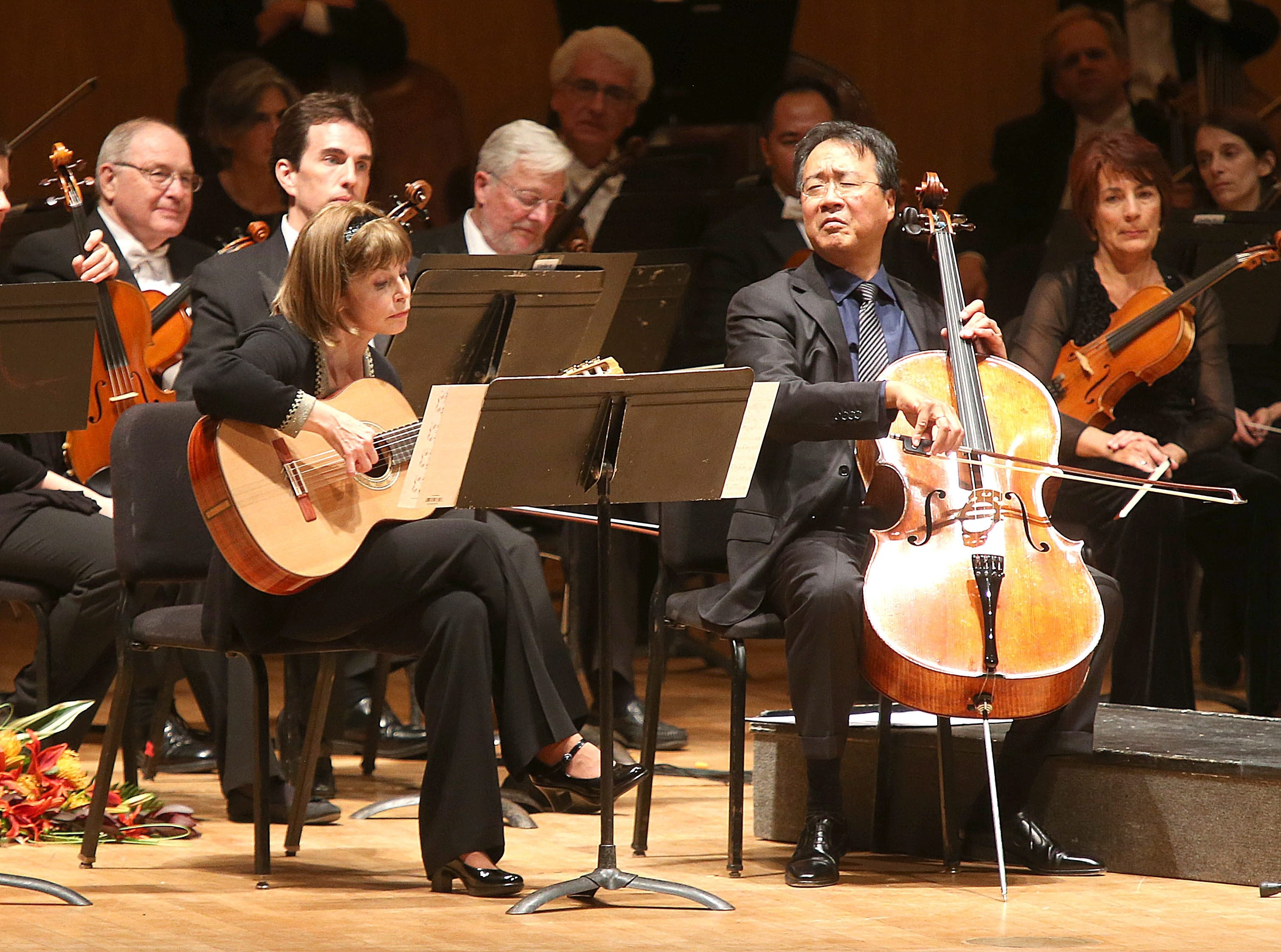 The crowd at the Buffalo Philharmonic Orchestra's opening concert Wednesday got a surprise in the first encore: BPO music director JoAnn Falletta on guitar accompanying superstar cellist Yo Yo Ma in Heitor Villa-Lobos' Bachianas Brasileiras, No. 5.
