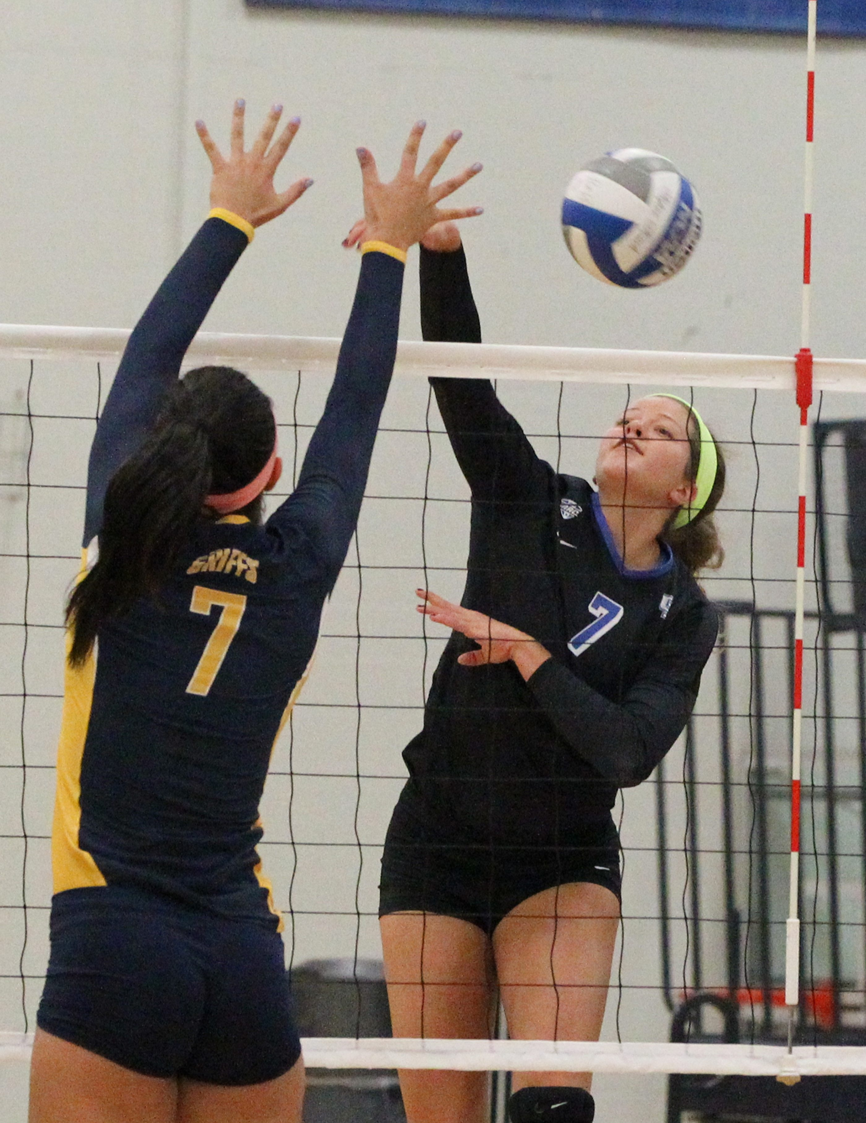 UB's Megan Lipski spikes the ball against Canisius' Rachel Kline during the Bulls' three-set victory Tuesday evening.