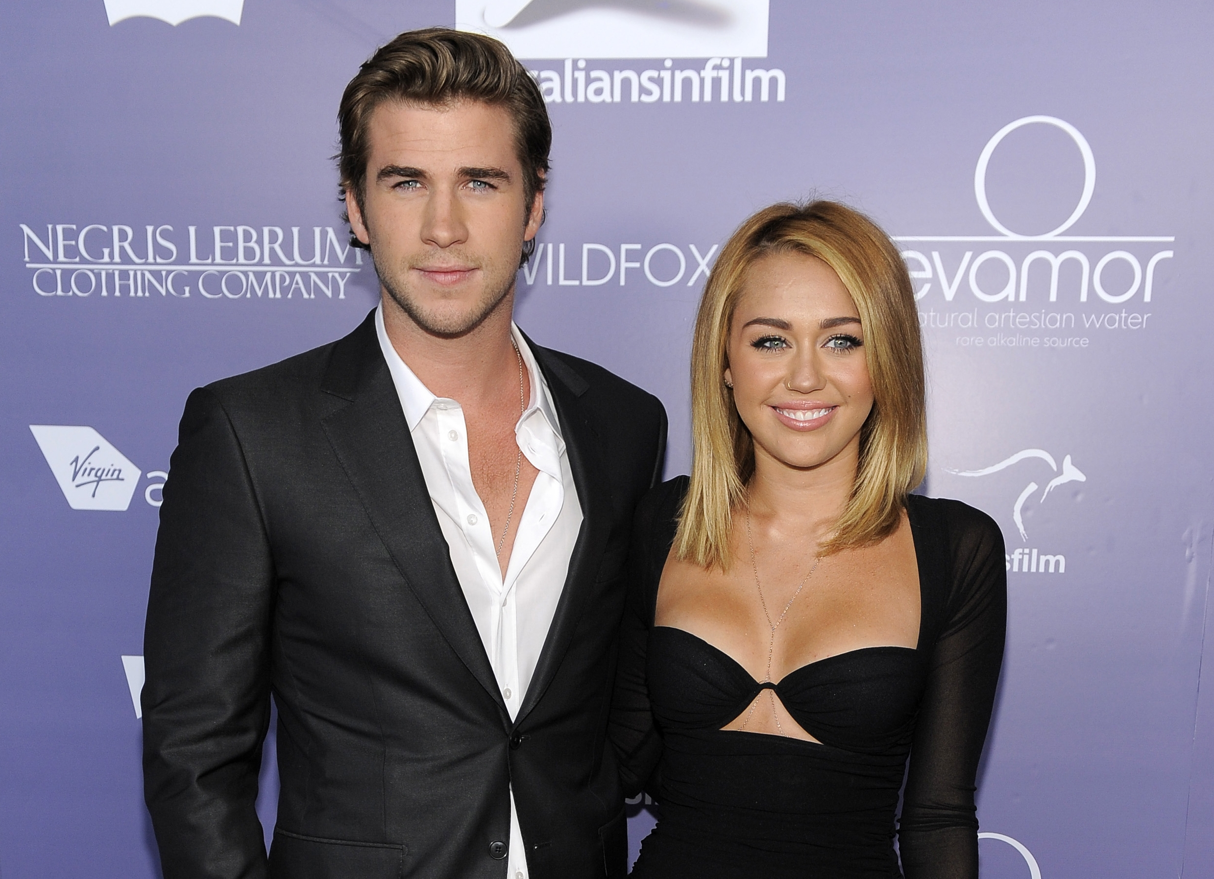 Actor Liam Hemsworth and his fiancé, Miley Cyrus, shown here in June 2012, have split up.