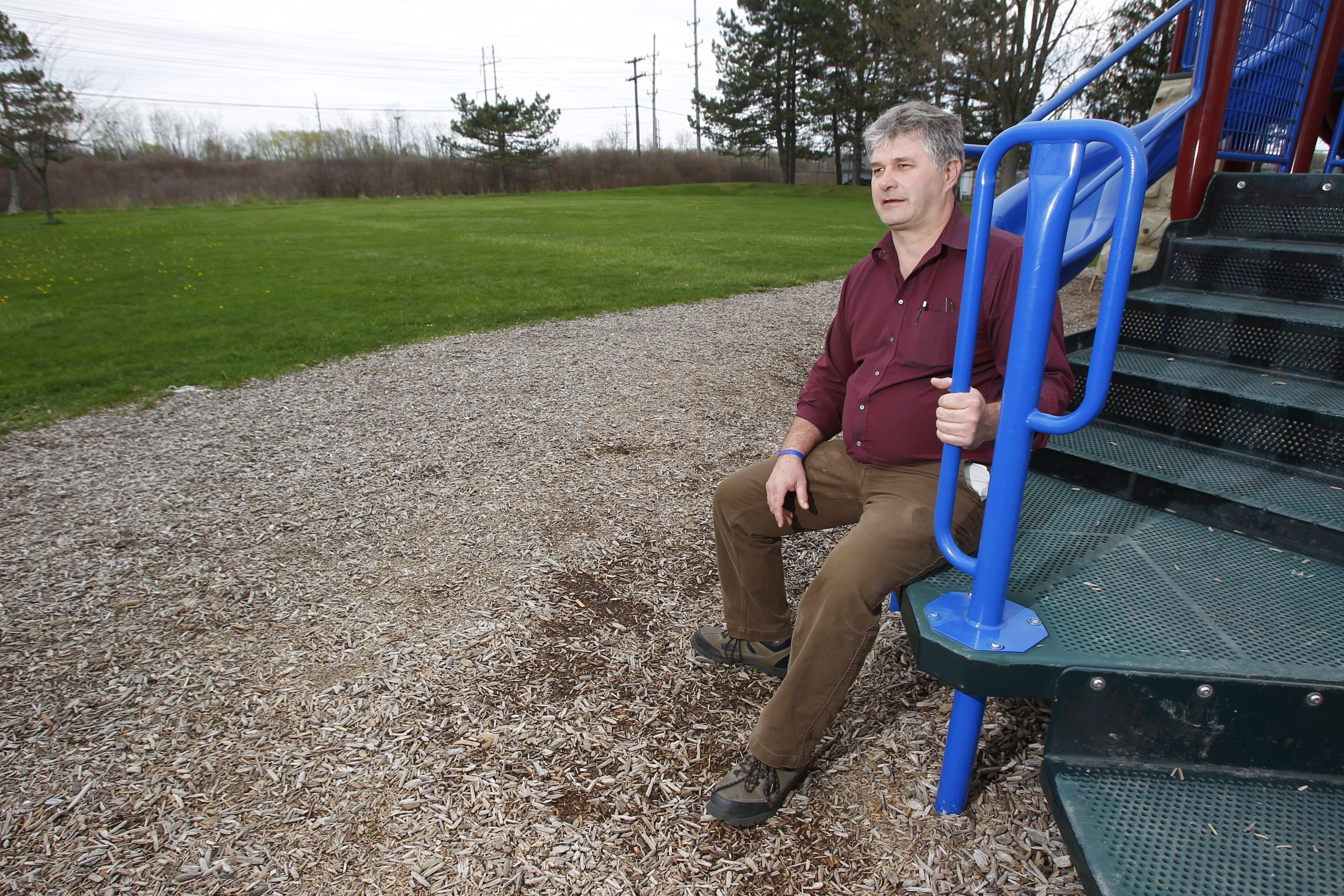 Bill Buchholz, in Lancaster's Keysa Town Park, looks at the site where a skate and bike park will be built in memory of his son, Bryce, 14, who was killed May 3, 2012, while riding his BMX bike in Lancaster. Increased costs will make a fall opening impossible.
