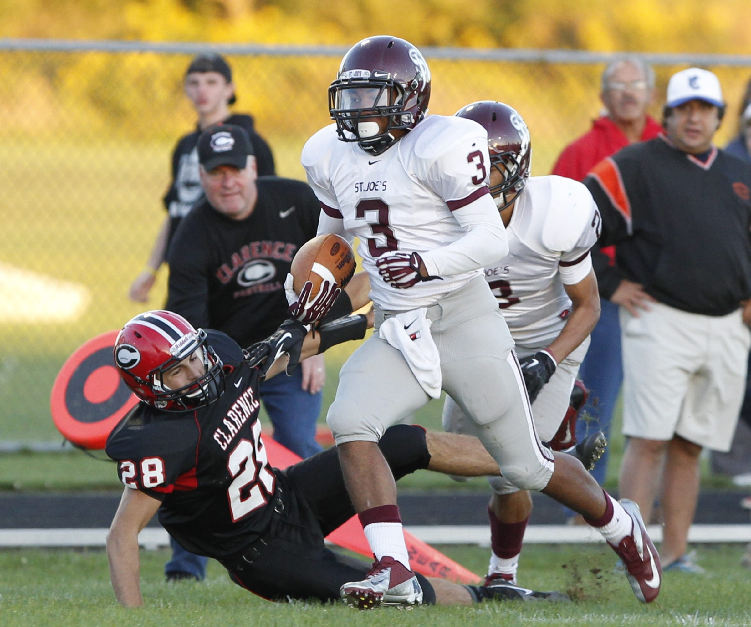 Nigel Davis scores one of his three touchdowns against Clarence during St. Joe's triumph.