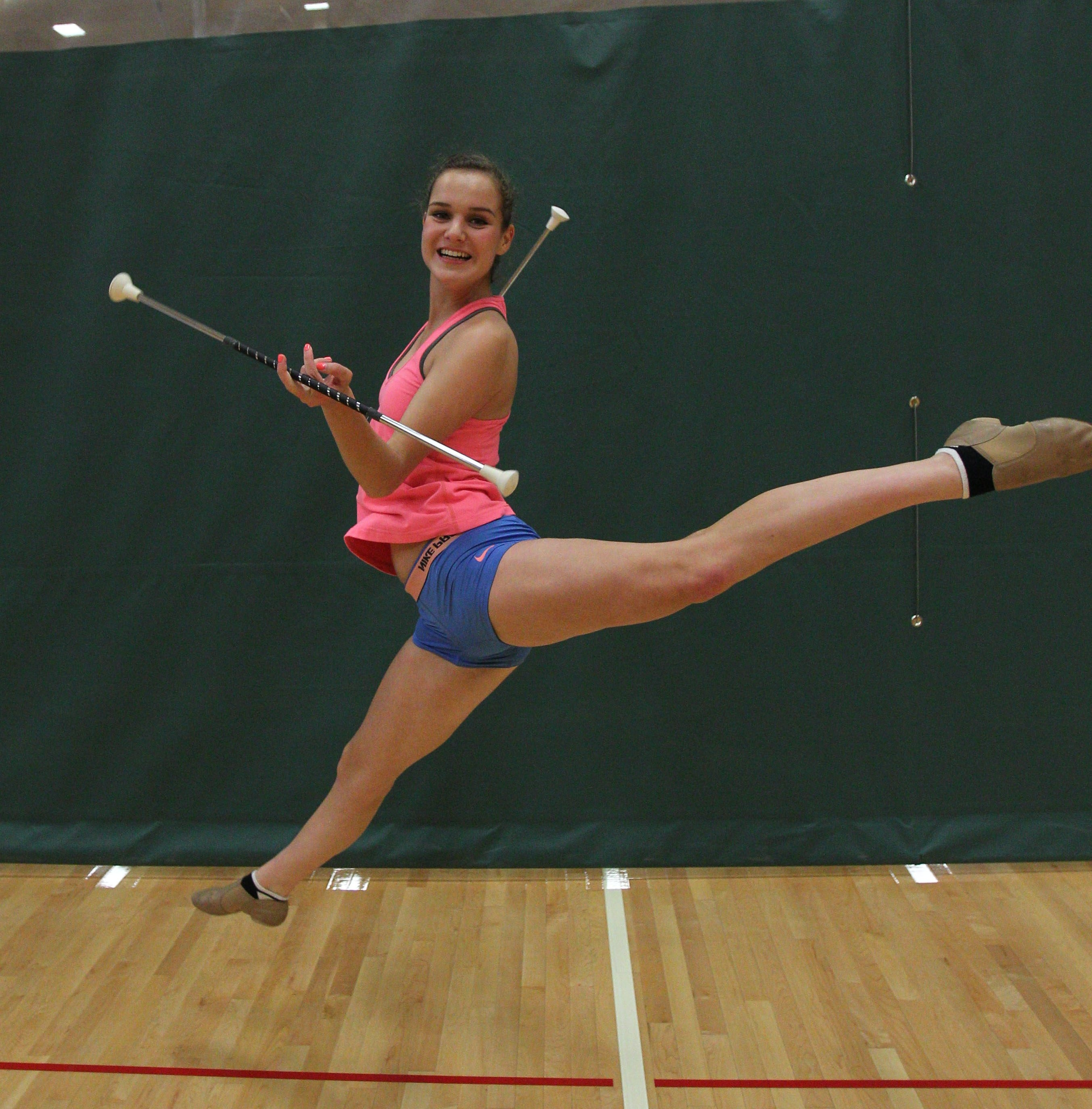 Bailee Russell, 16, practices her baton twirling routine for the upcoming trip to Peru this week. She will join 11 other U.S. twirlers for the International Festival of Springtime in Trujillo, a trip her mother and sister also made whey they were her age.