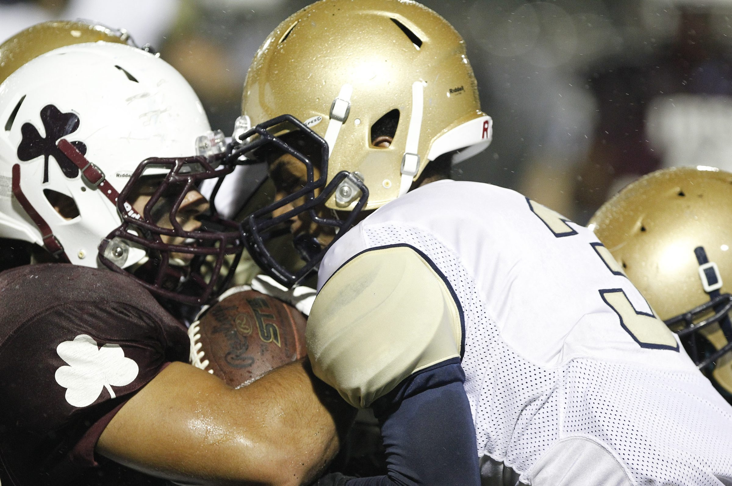 Canisius defender Mitchell Thomas goes face-to-face with Aquinas running back Luke Pietropaolo during Friday's game at Aquinas. More high school football photographs and scores on Page B6.