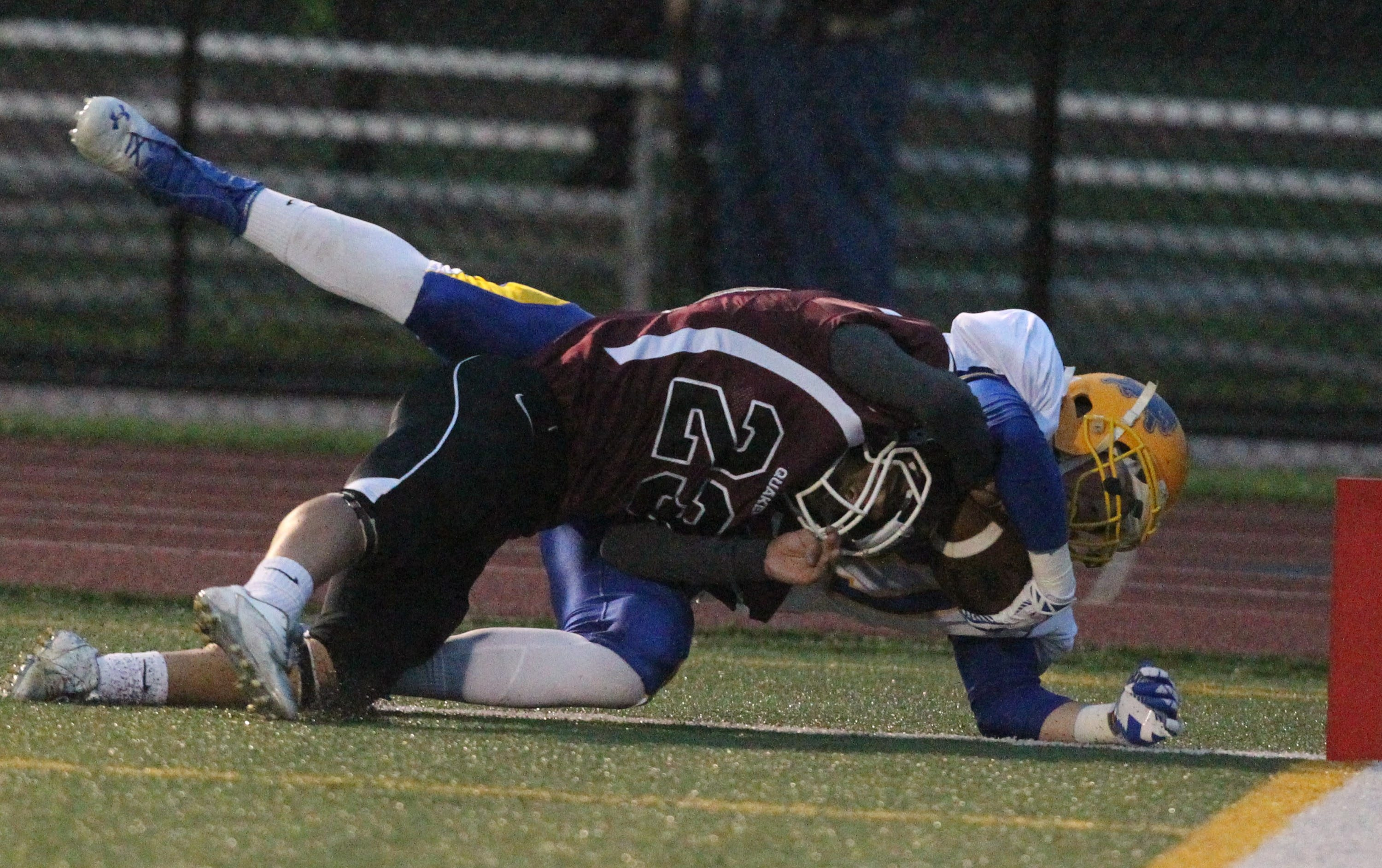 Lockport's Charlie Sobieraski catches a touchdown pass over Orchard Park's Murray Logan in the second quarter.