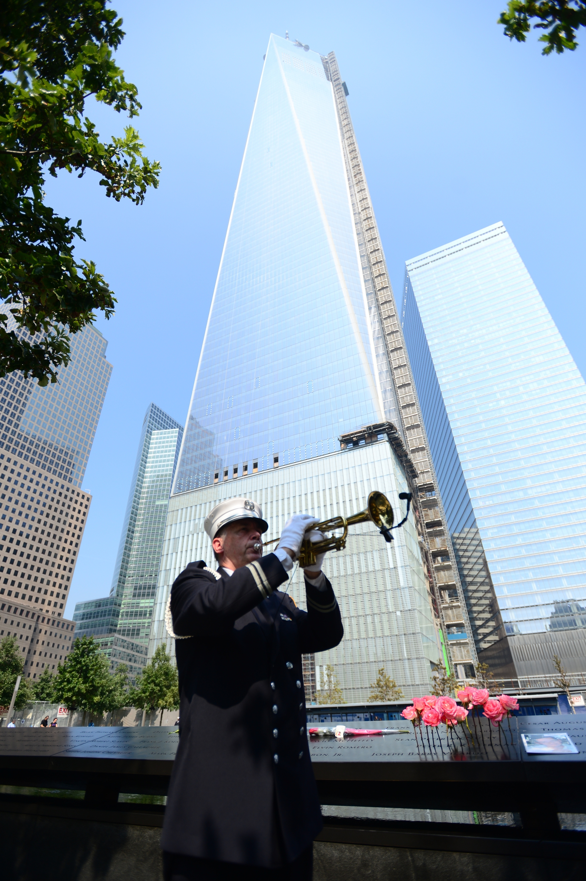 New York Fire Department Captain Tom Engel plays taps at the 9/11 Memorial during ceremonies Wednesday for the 12th anniversary of the Sept. 11, 2001, terrorist attacks.