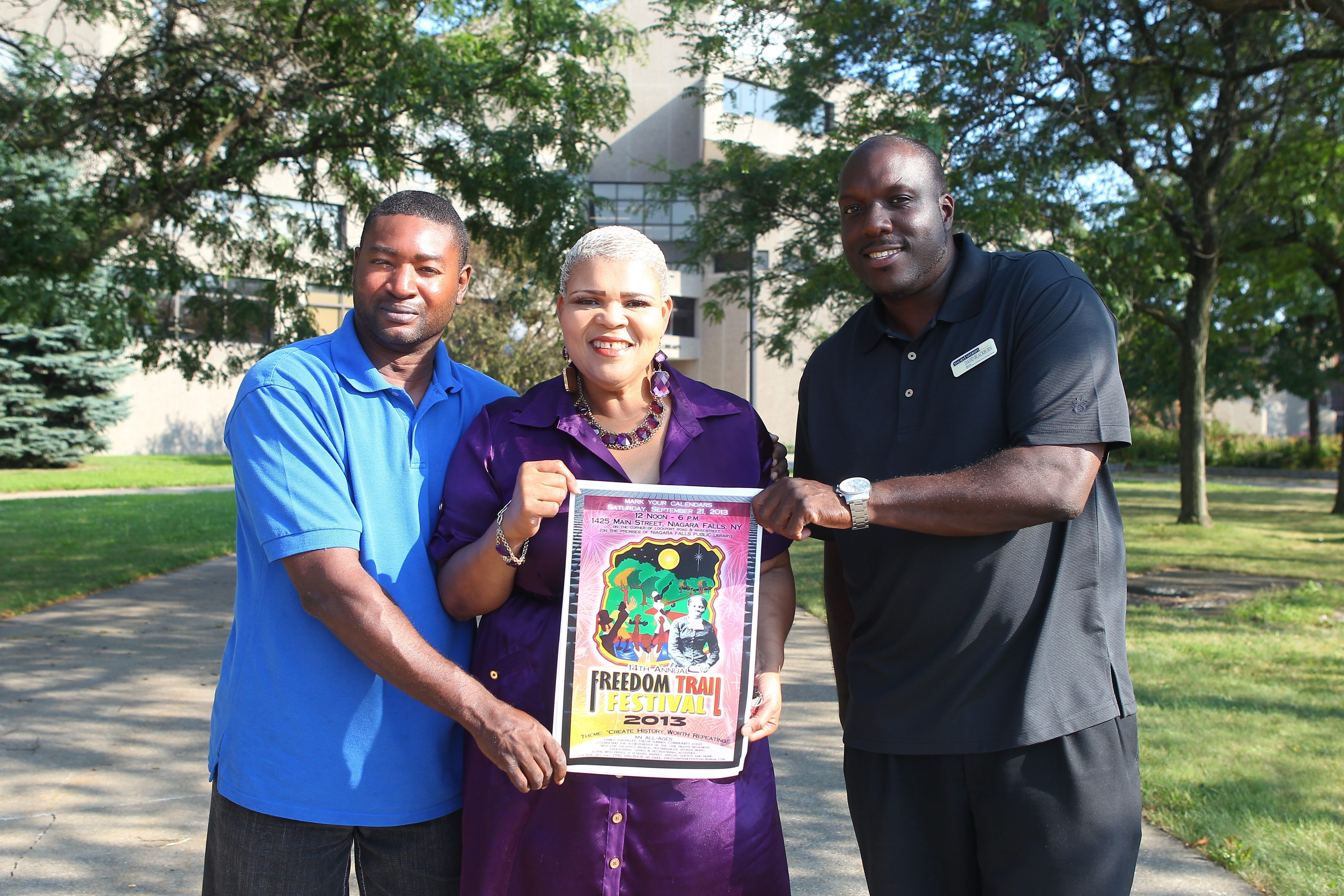 David Blackburn, right, organizer of the Freedom Trail Festival, joins with gospel singer Marsha McWilson and her husband, Howard, to display a poster advertising the event, which will run from noon to 6 p.m. Saturday.