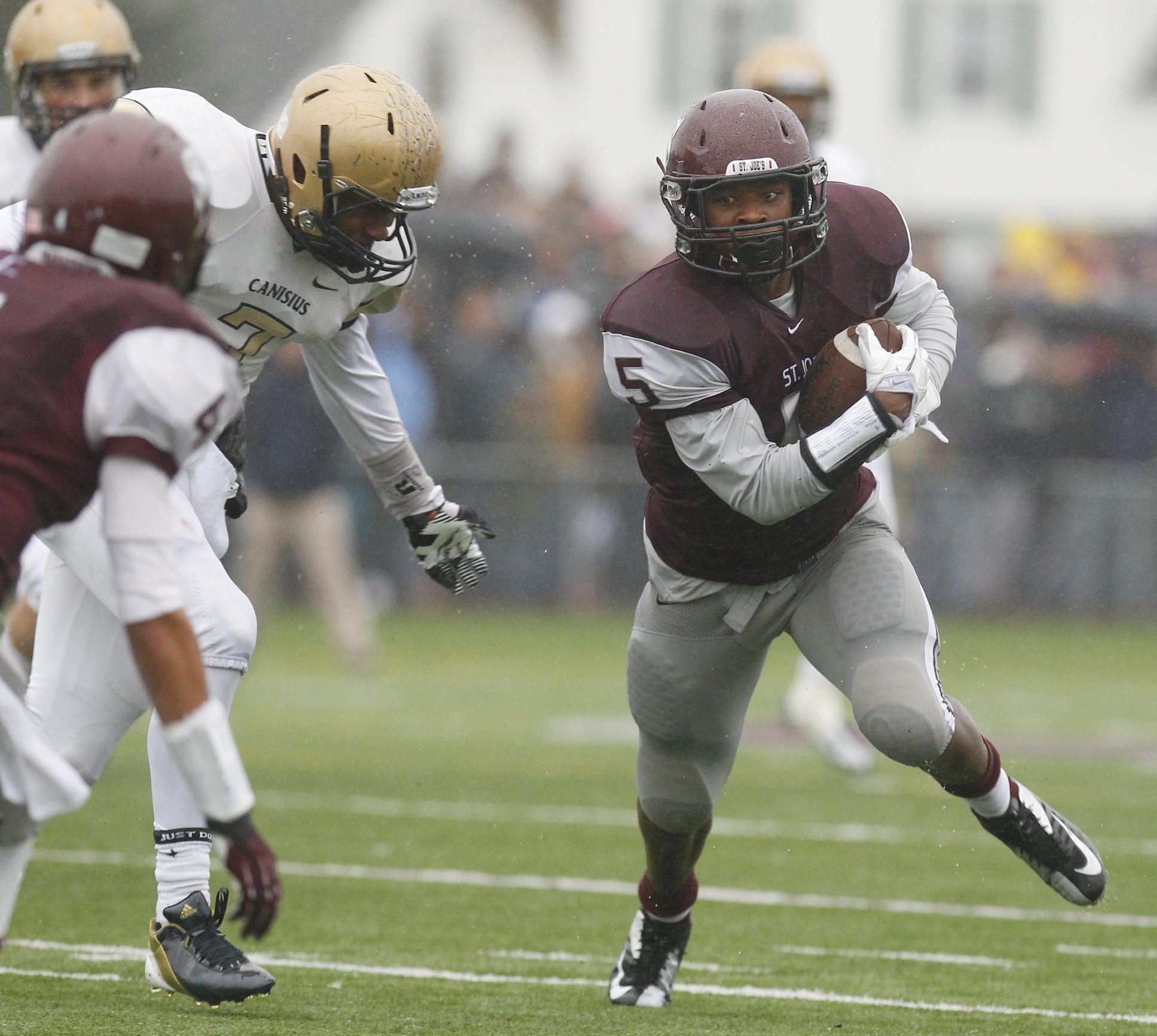 St. Joe's Roderick Payne tries to break away from Canisius' Qadree Ollison during the first half of the game at St. Joe's Saturday, October 27, 2012.