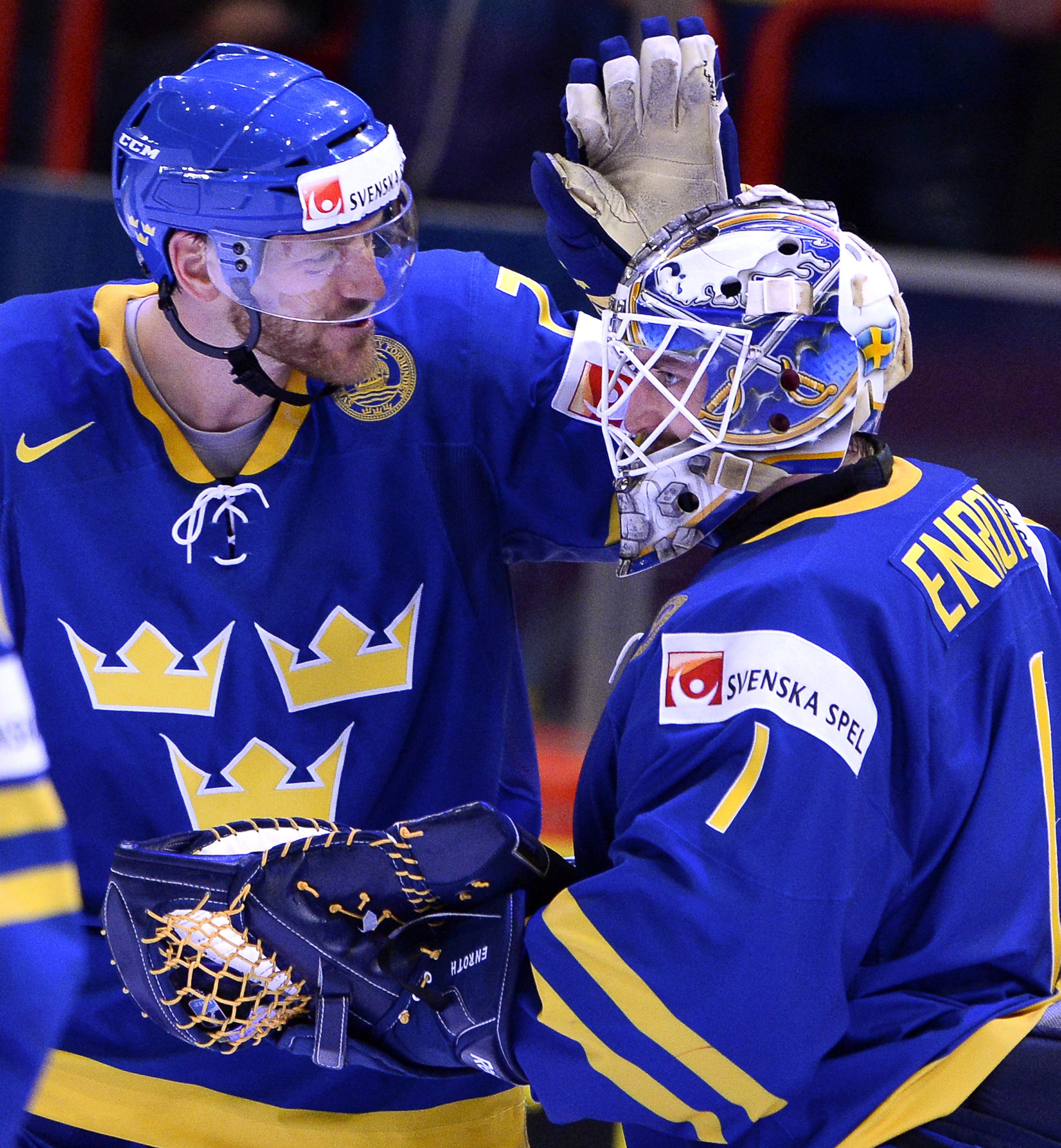 Henrik Tallinder, left, is back with the Sabres and goalie Jhonas Enroth. They helped Sweden win gold in the World Championships.
