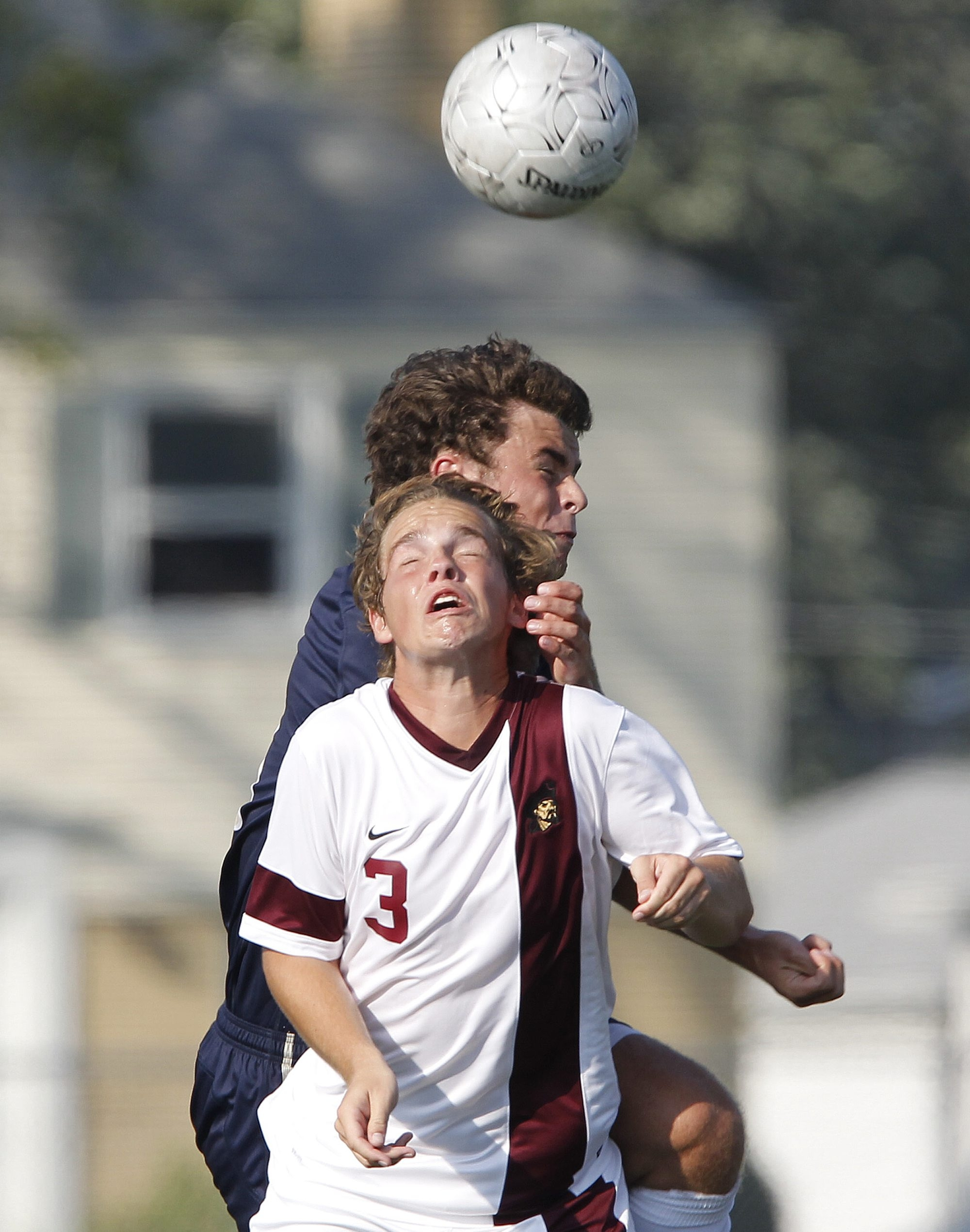 Matthew Brunner Dempsy of St. Joe's, front, collides with Canisius' Harry Clough in the Crusaders' 1-0 victory.