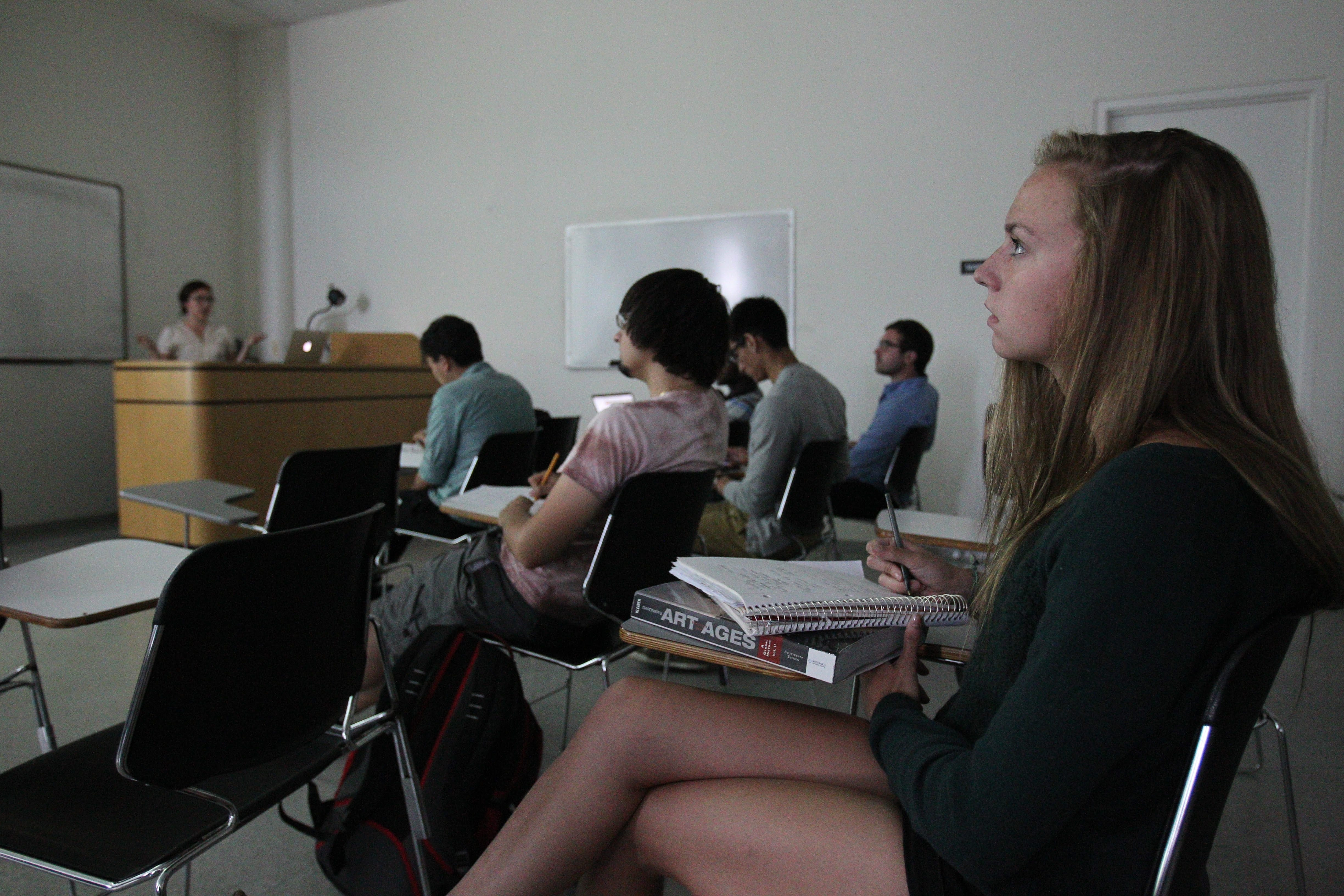Kelsey Ables took an art history class at UB this summer.  She's listening to a lecture,Tuesday, July 30, 2013. Here the class is listening to a lecture while looking at slides of artwork.  (Sharon Cantillon/Buffalo News)