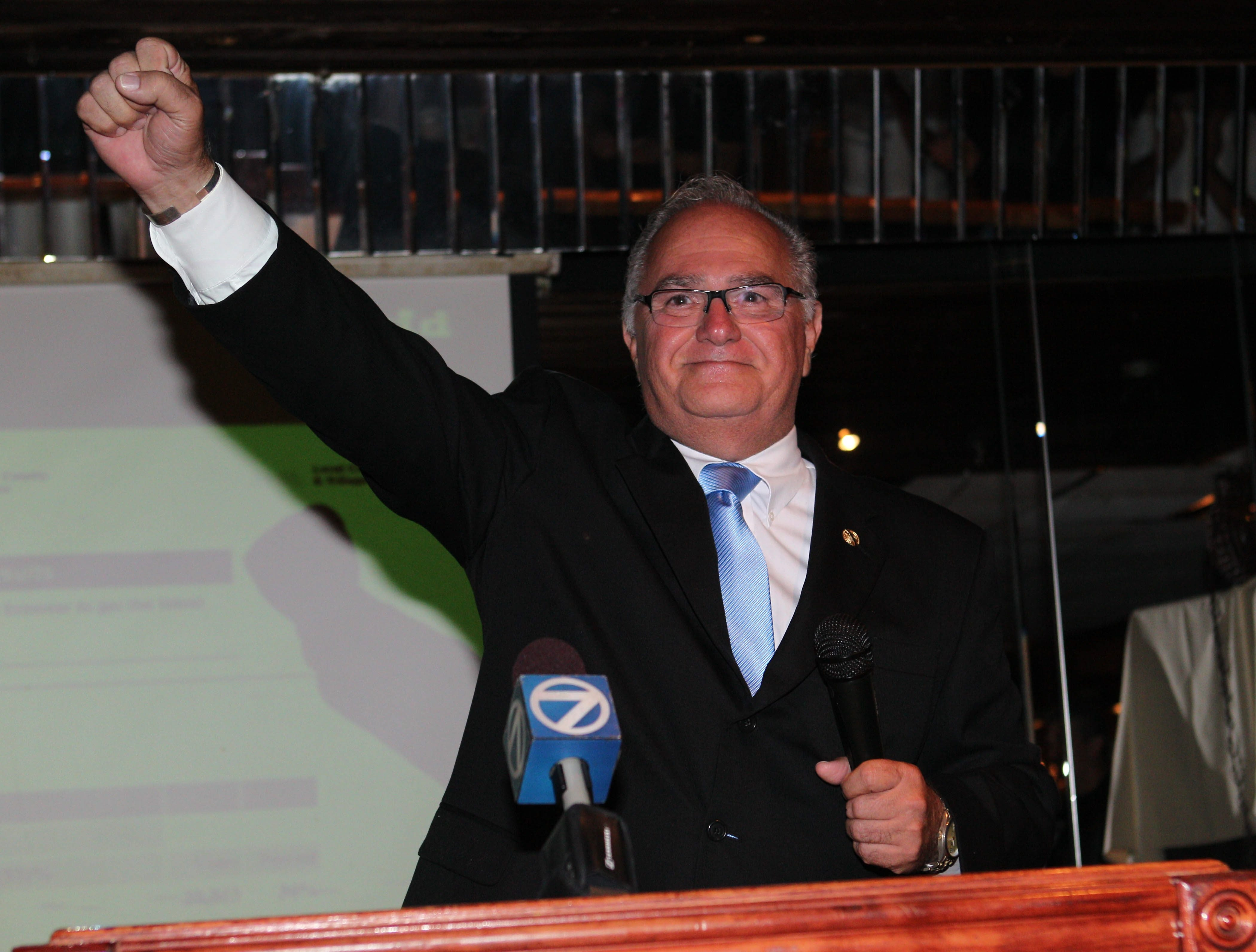 Richard E. Dobson, candidate for Erie County sheriff, declares victory in the Democratic primary against Bert D. Dunn on Tuesday.