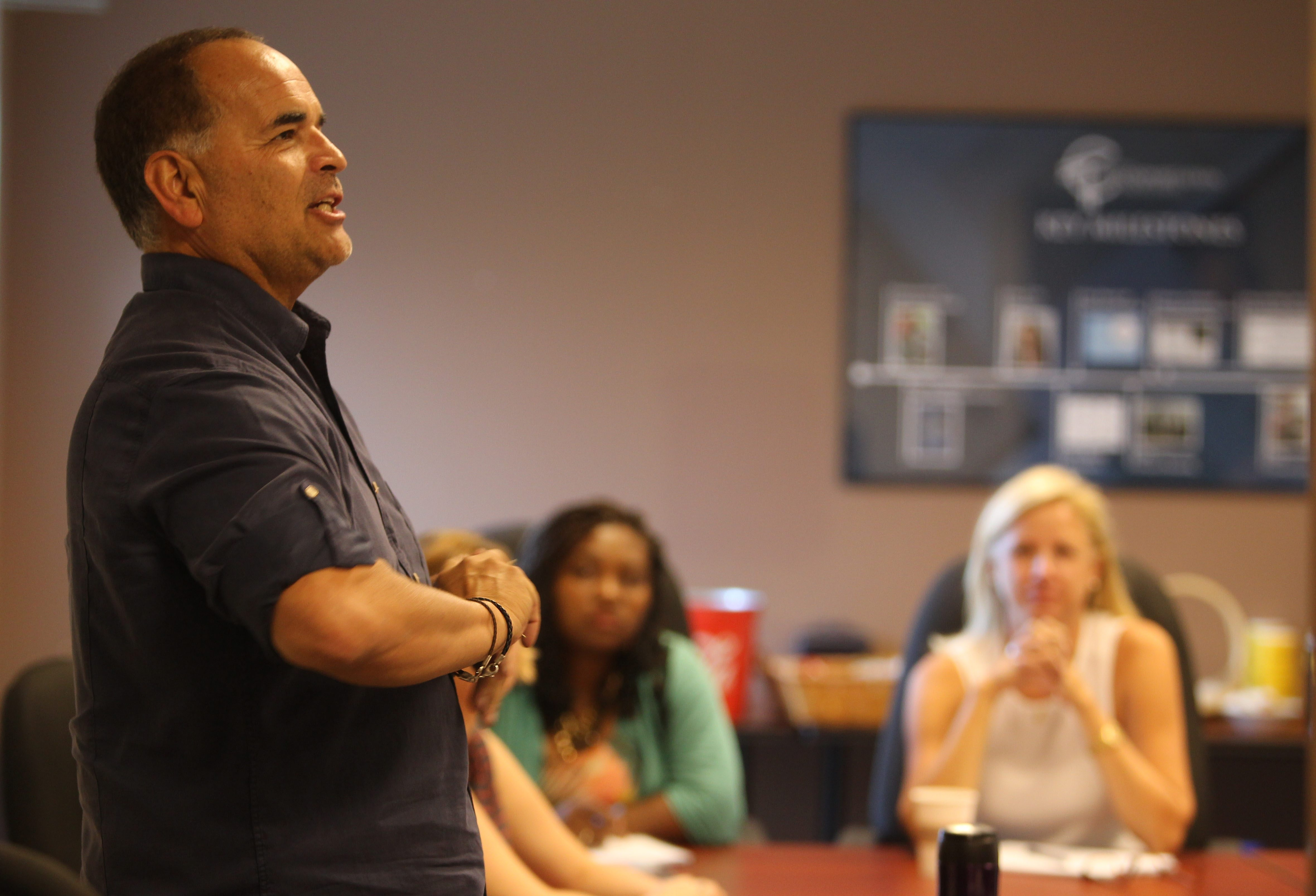 Former street tough Richard Ramos, addressing a group at Center for Transportation Excellence on East Amherst Street Tuesday, will be keynote speaker at a free, public community conversation at 6 p.m. Thursday in Bennett High School.