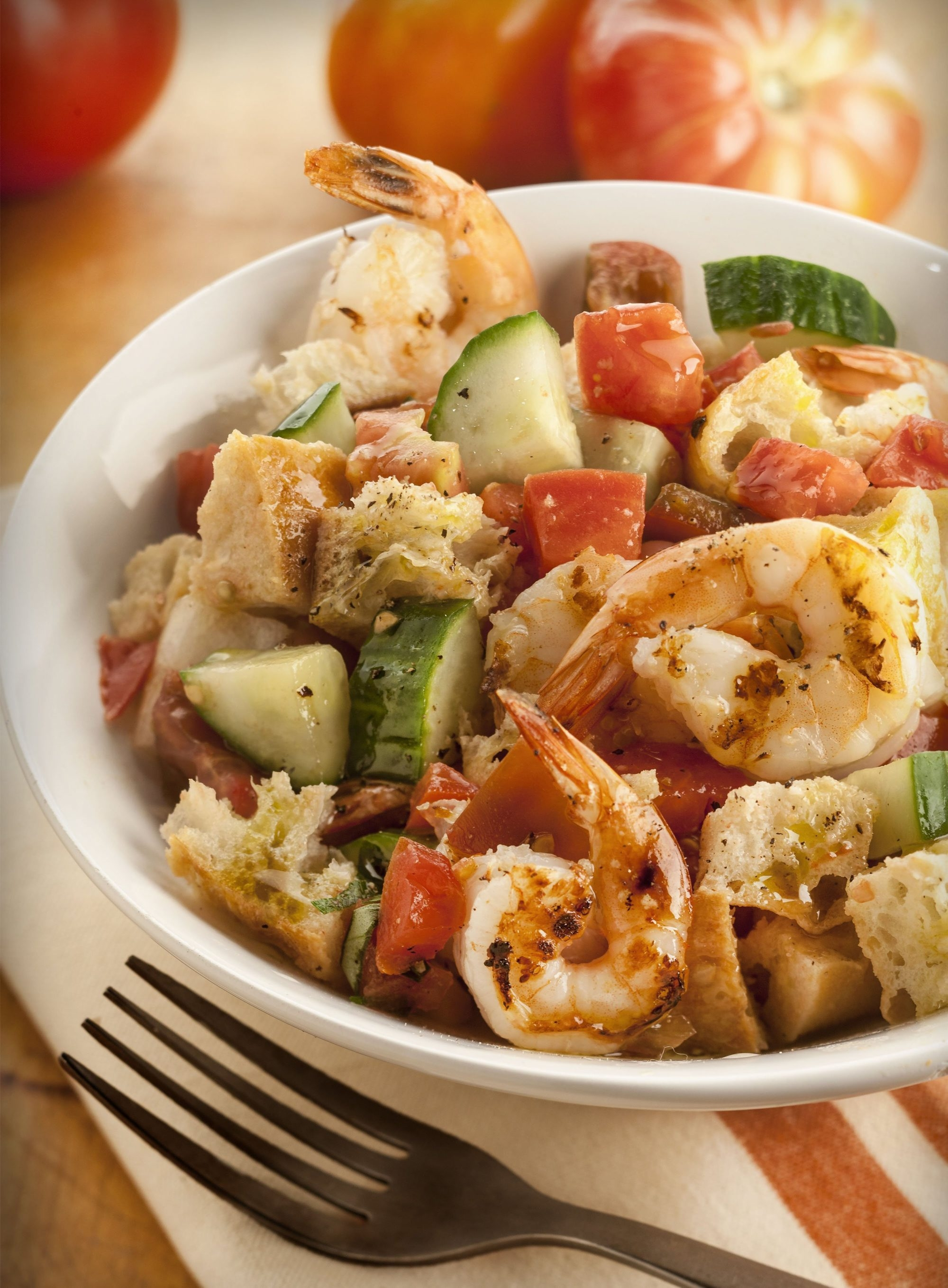 Panzanella is an Italian bread and tomato salad studded with crisp onion and cooling cucumber.