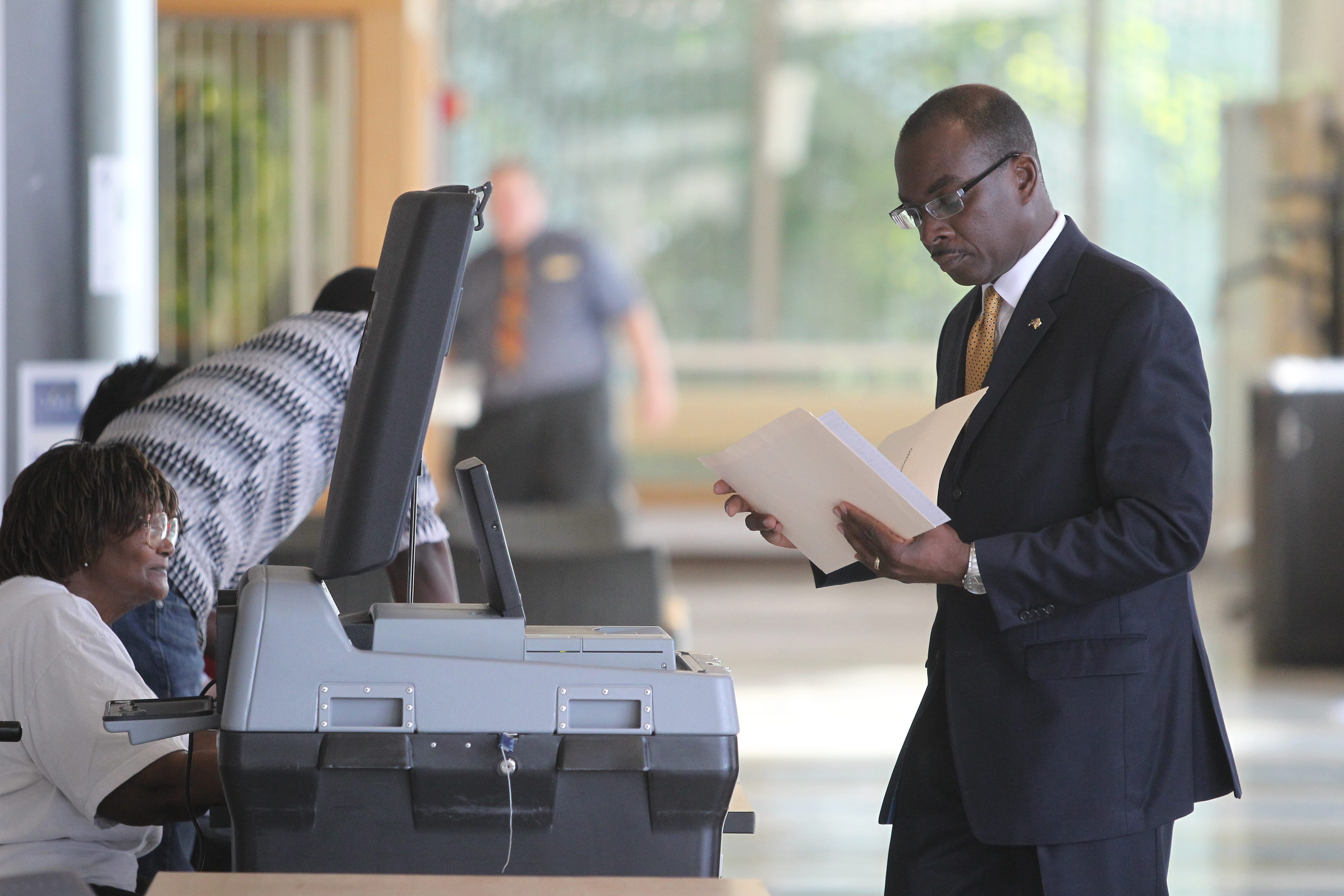 Incumbent Mayor Byron Brown, facing a challenge from Bernard Tolbert in today's Democratic primary voting, checks his ballot before submitting it as he and his wife Michelle vote at the Canisius College Student Center this morning.