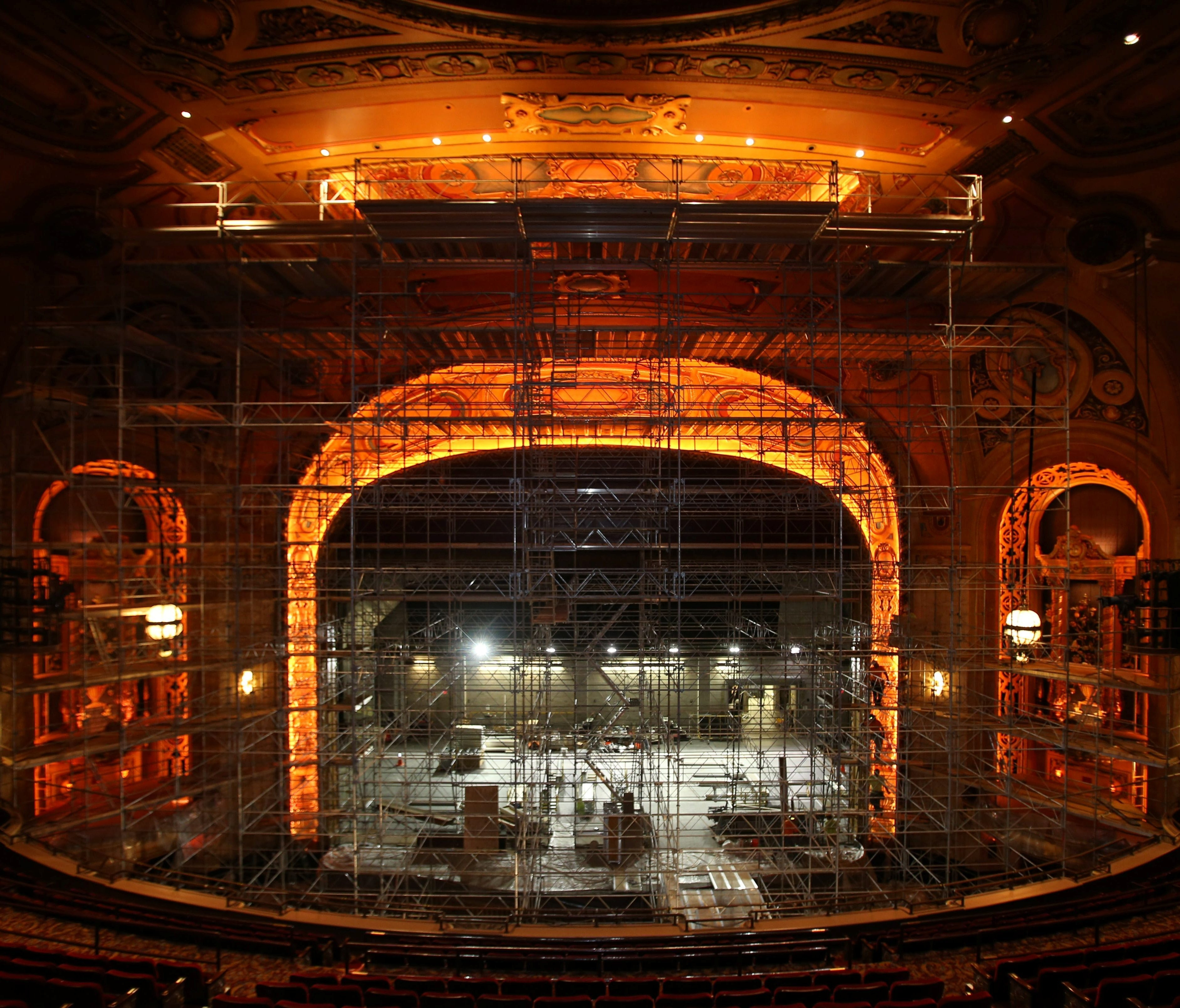 Workers remove scaffolding after completing extensive work on the proscenium and other areas around the stage at Shea's Performing Arts Center.
