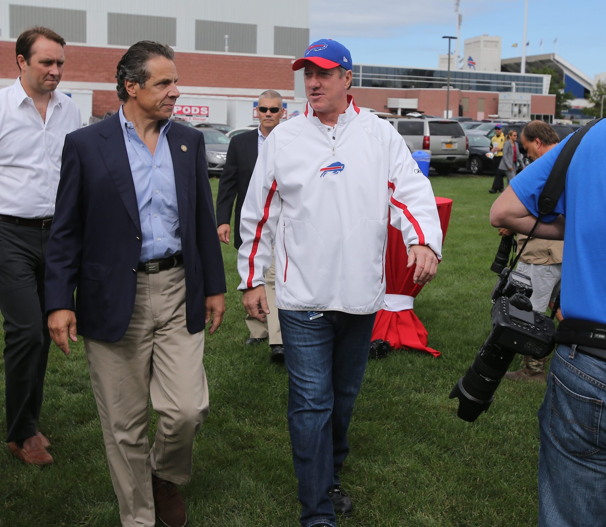 """New York Gov. Andrew Cuomo, left, talks with former Buffalo Bills quarterback Jim Kelly, outside of Ralph Wilson Stadium in Orchard Park during the """"Governor's Tailgate Party"""", Sunday, September 8, 2013.  (Charles Lewis/Buffalo News)"""