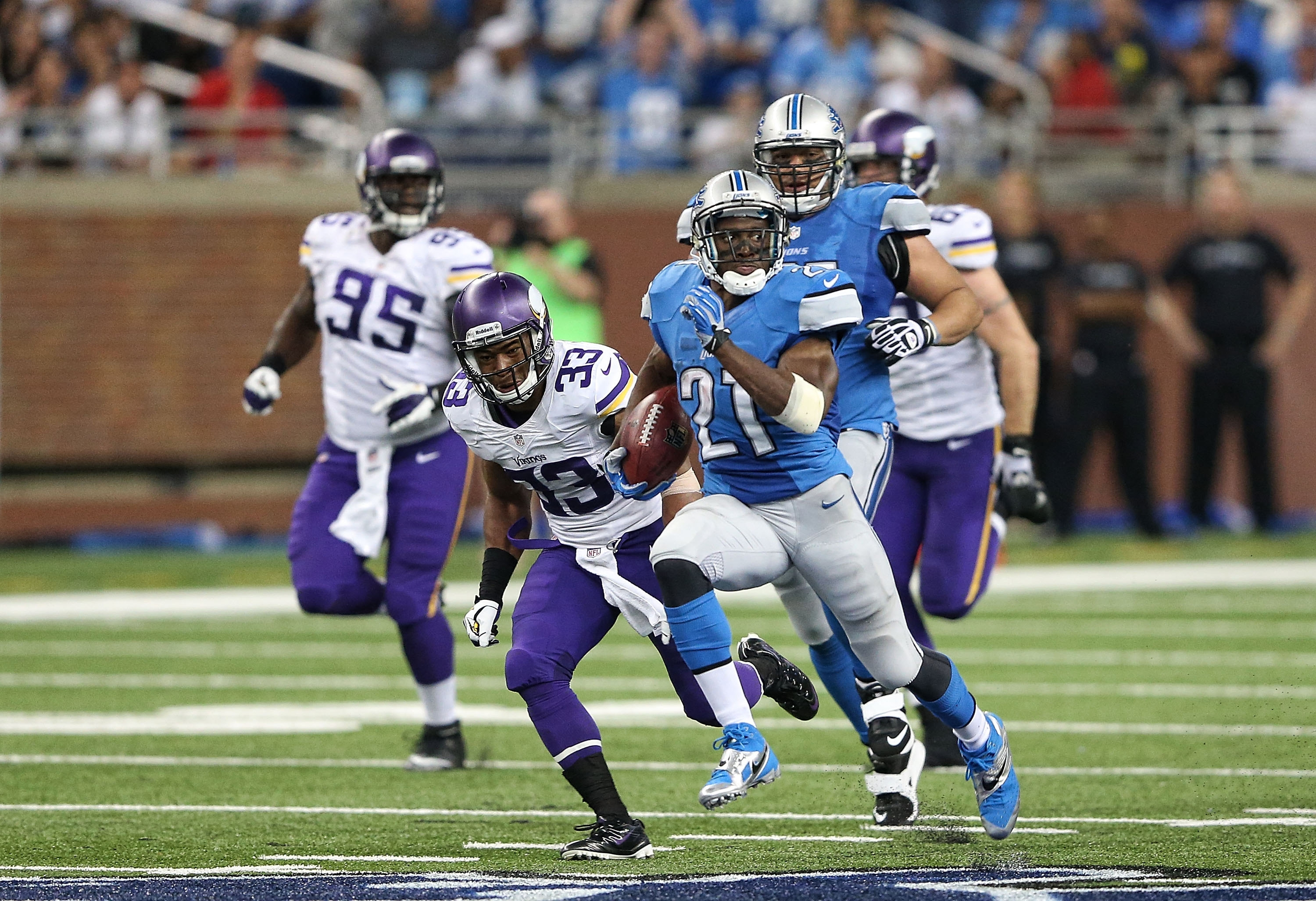 Reggie Bush races 77 yards for a third-quarter touchdown during the Detroit Lions' 34-24 win over Minnesota. Bush, making his Lions debut, accounted for 191 yards in total offense.