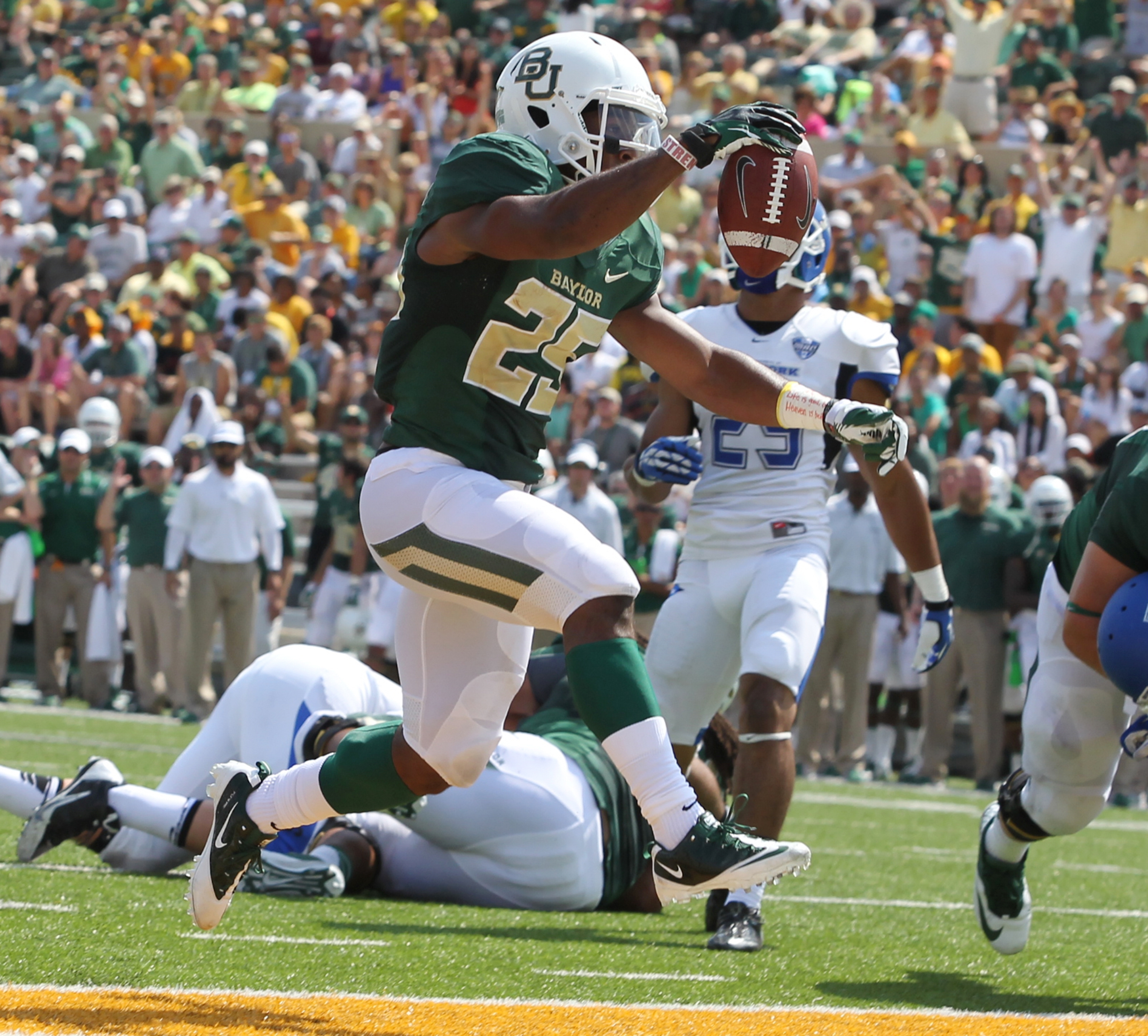 Baylor running back Lache Seastrunk celebrates one of his three first-half touchdowns against UB.
