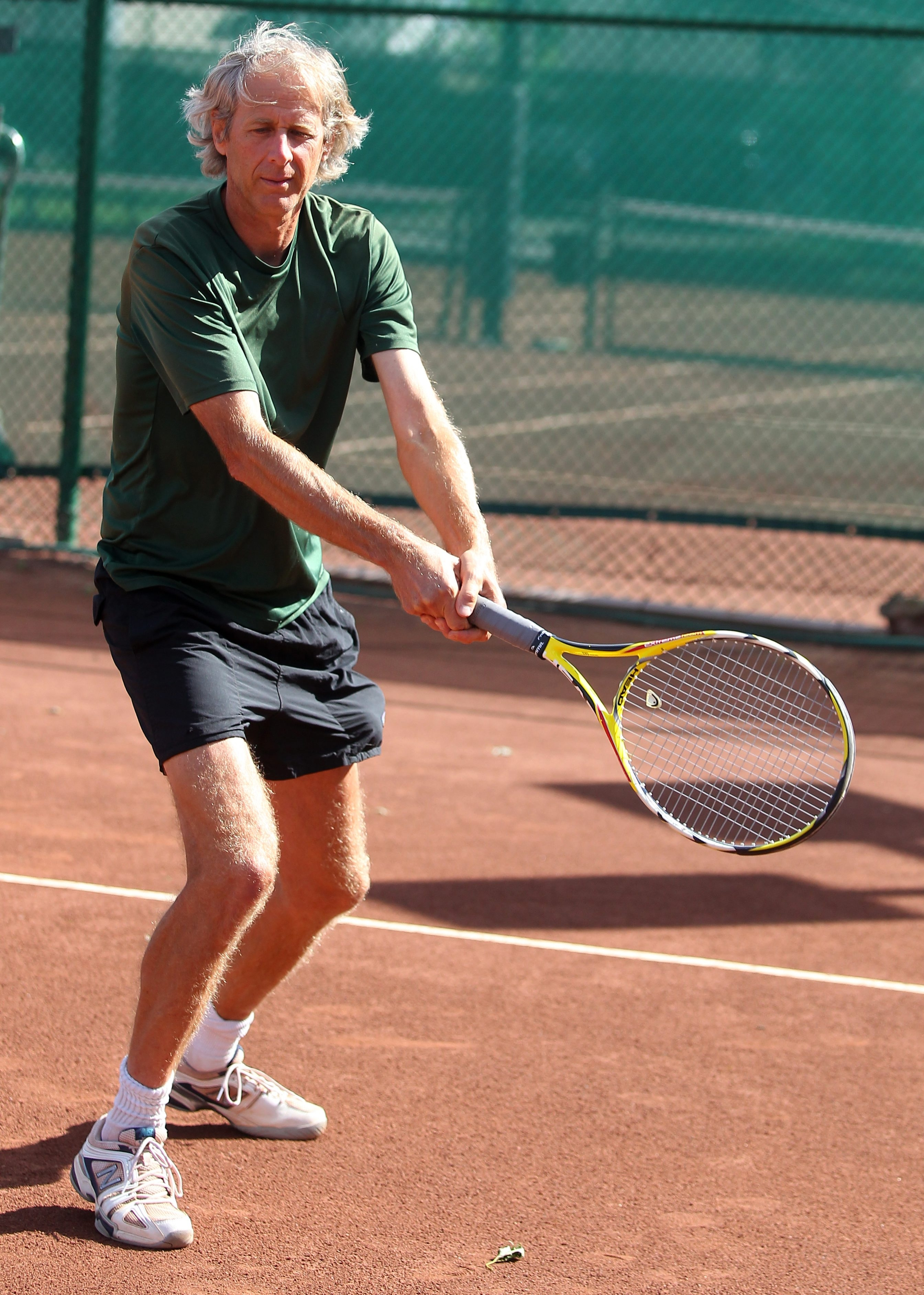 Dave Magavern demonstrates his unusual backhand grip for tennis that has served him well in regional competition.