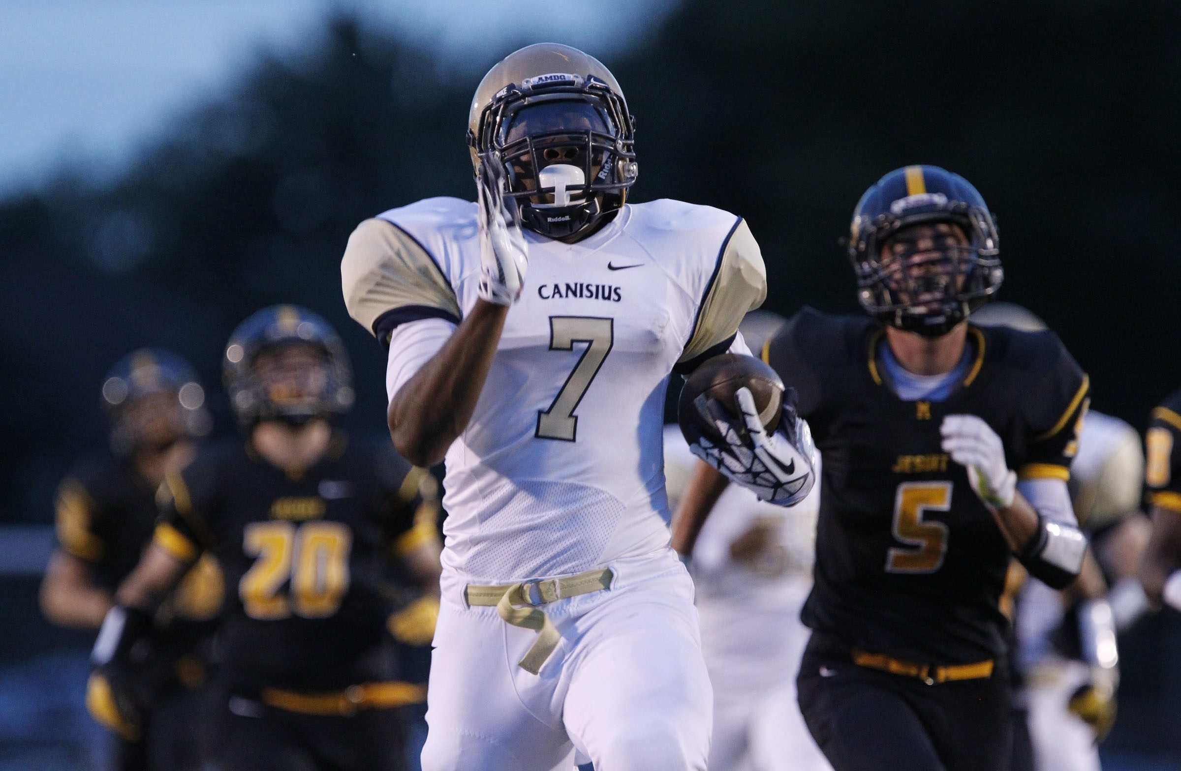 Canisius running back Qadree Ollison heads to the end zone on a 65-yard run against McQuaid. More high school football coverage on pages B6 and B7.