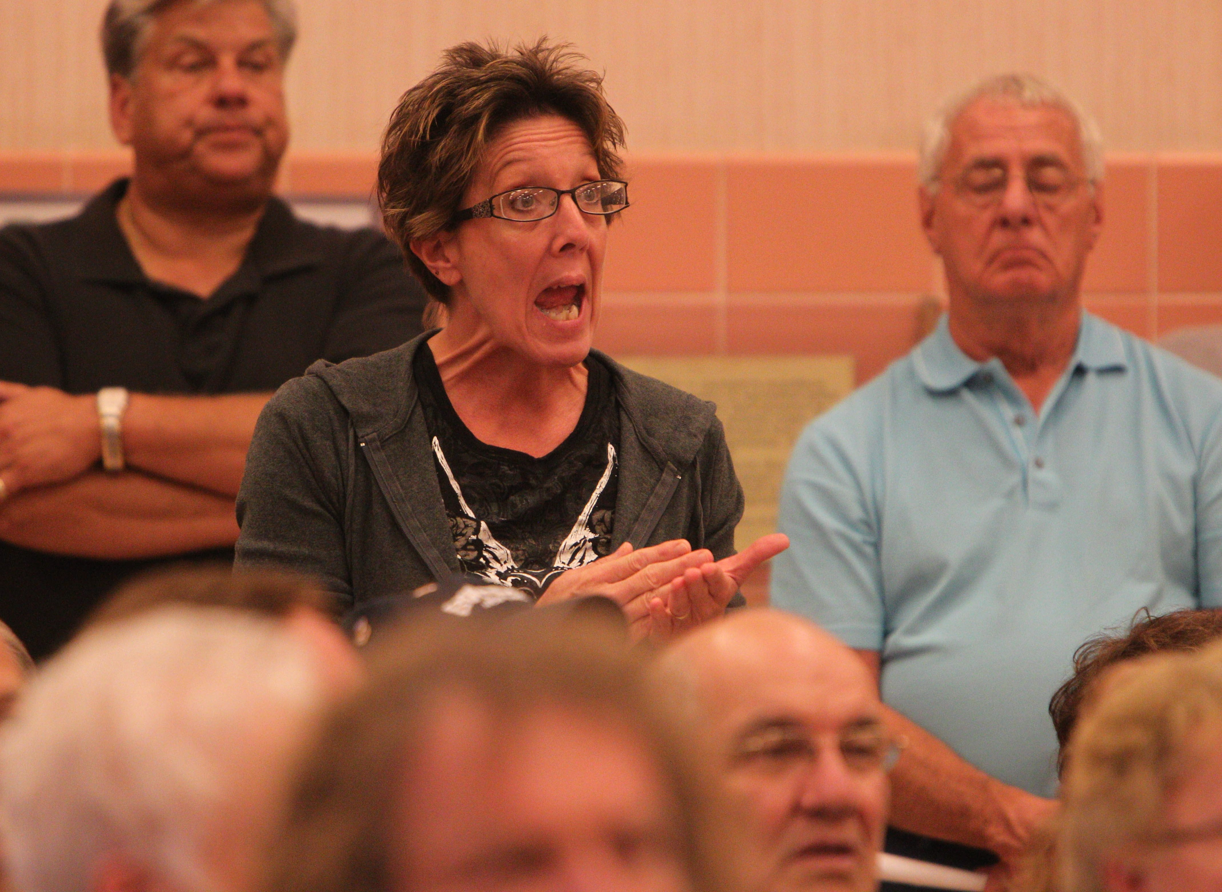 Cheektowaga resident Cheryl Lockhart expresses opposition to a plan to convert property assessments in the town to full market value in a meeting Thursday.
