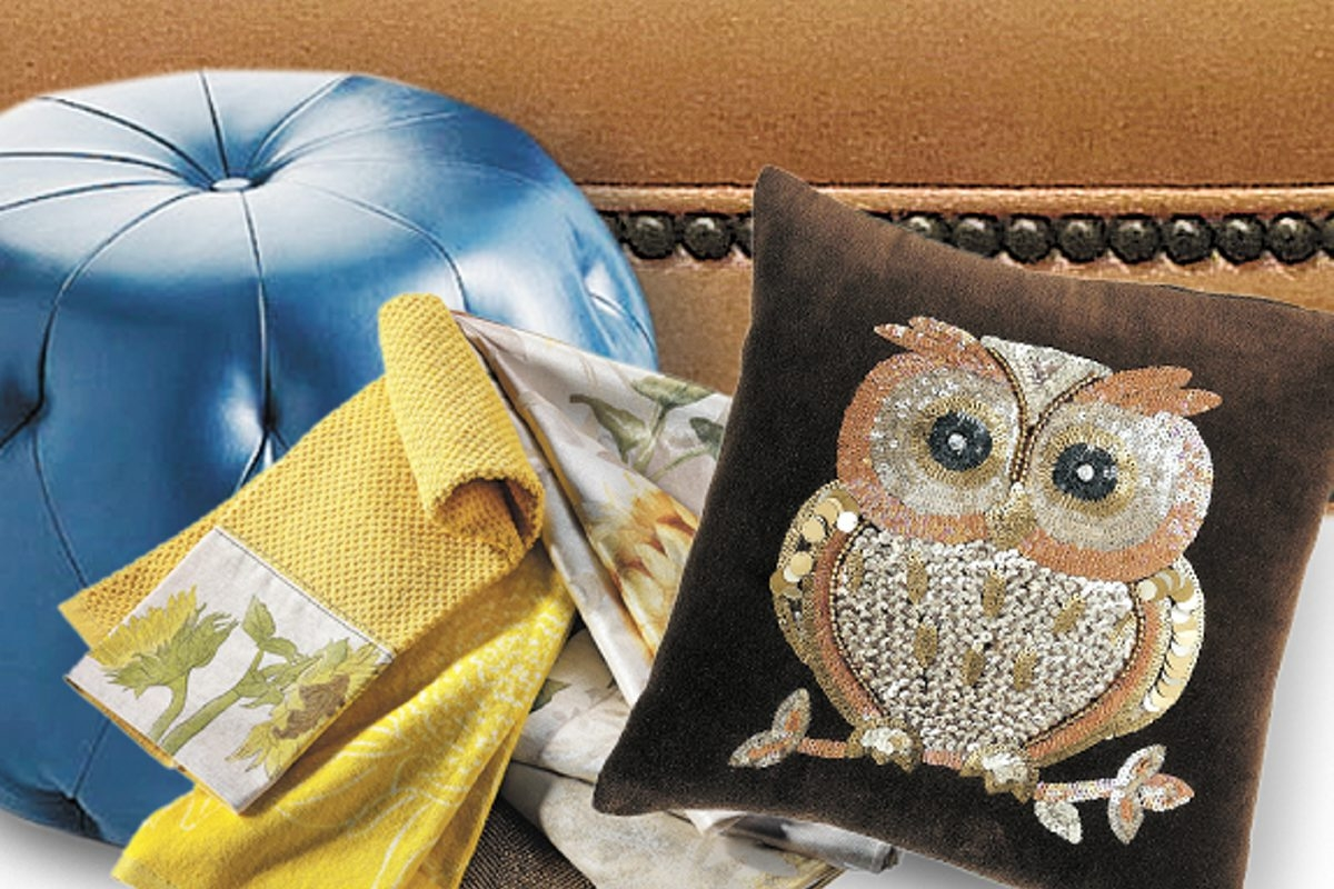 Owl pillow and ottomans, Pier 1; bench with nailhead trim, Calico in Williamsville and bronze place mat with sunflower linens, Kohl's.