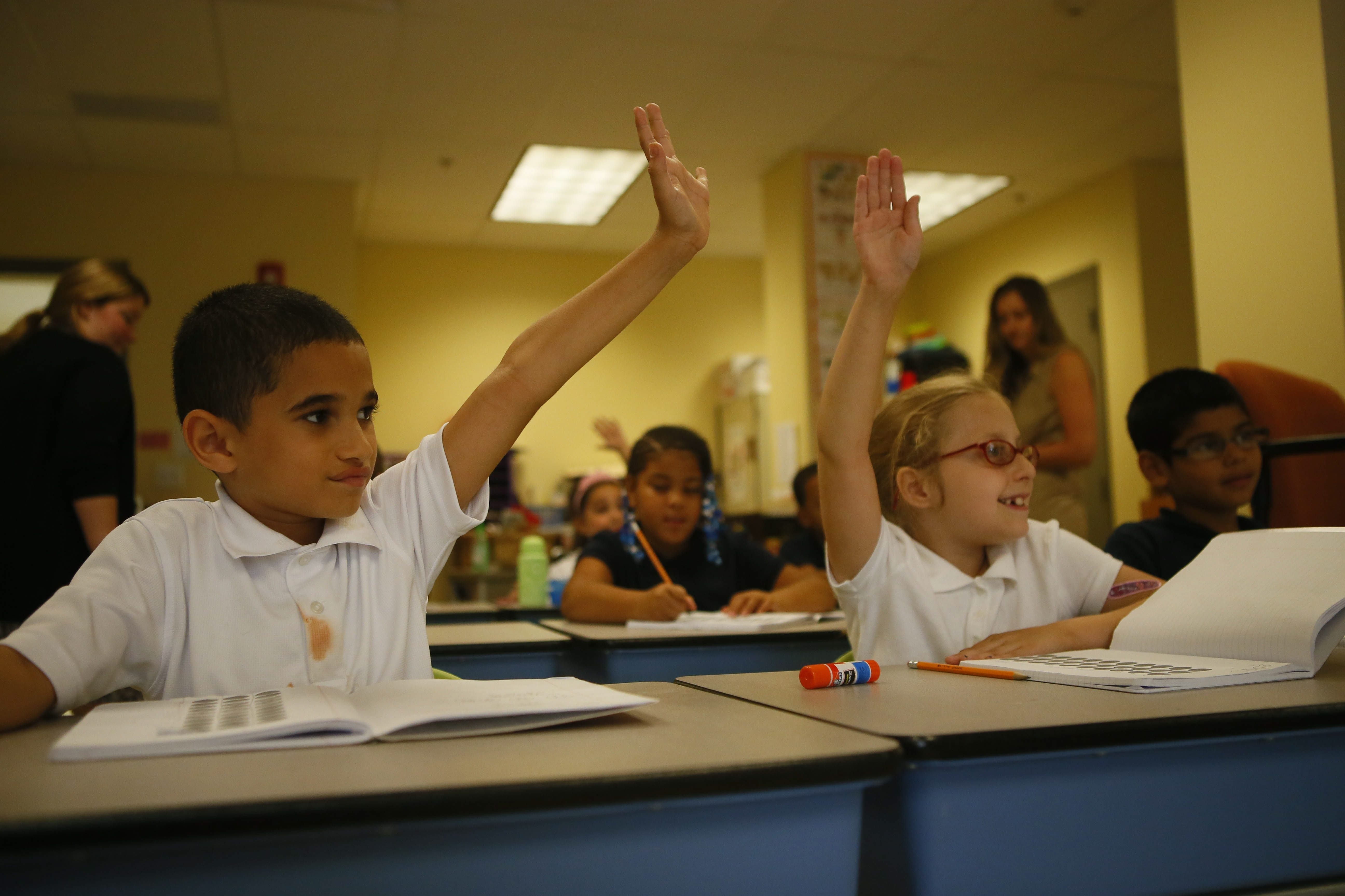 West Buffalo Charter School, which opened last year, structured much of its curriculum around Common Core standards. Here, third-graders Hector Perez Tirado and Danielle Dickman participate in a math class.