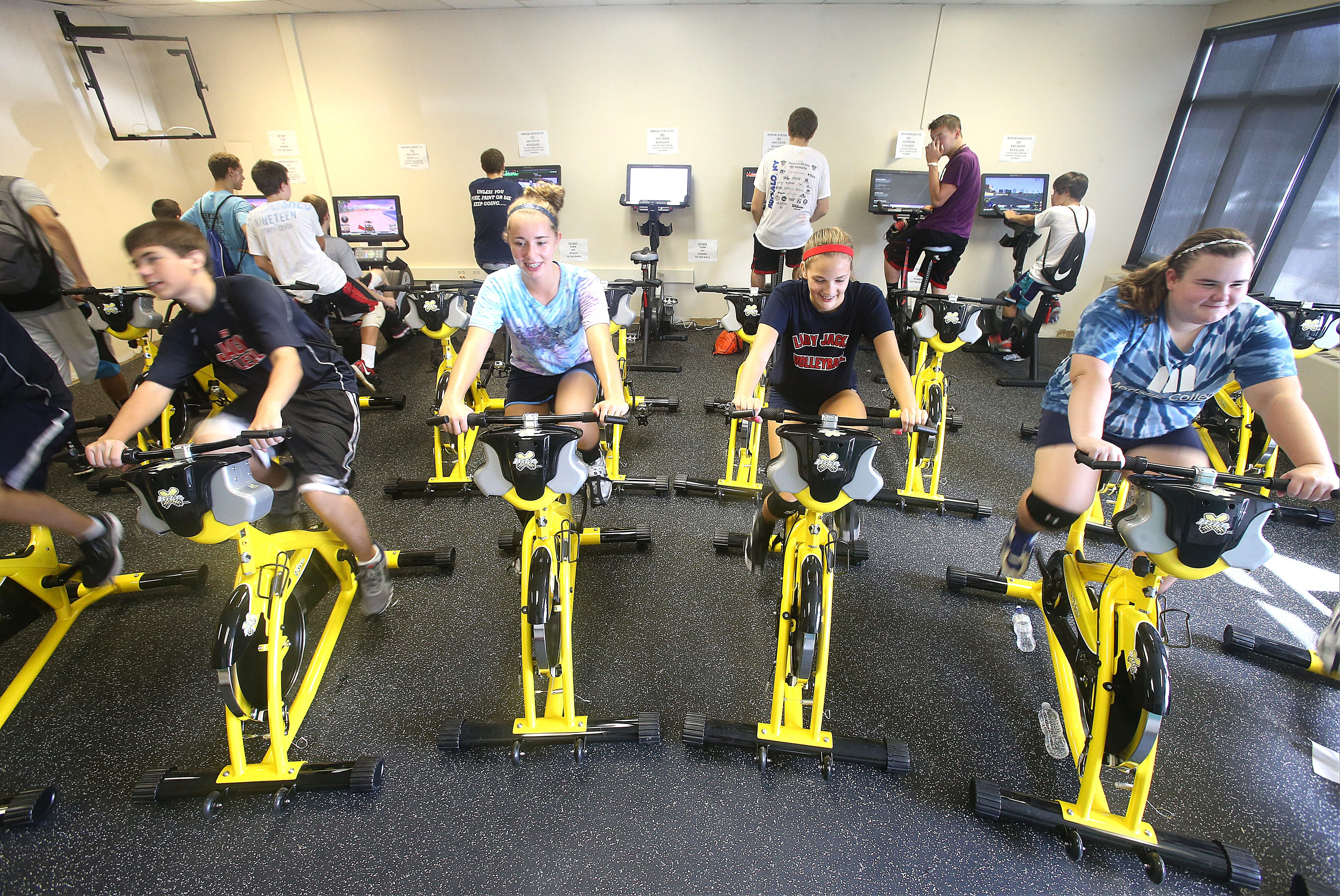 North Tonawanda High School volleyball teammates hone their competitive interests while riding the new interactive bikes designed to spur a lifetime commitment to fitness in the renovated and expanded gymnasium.