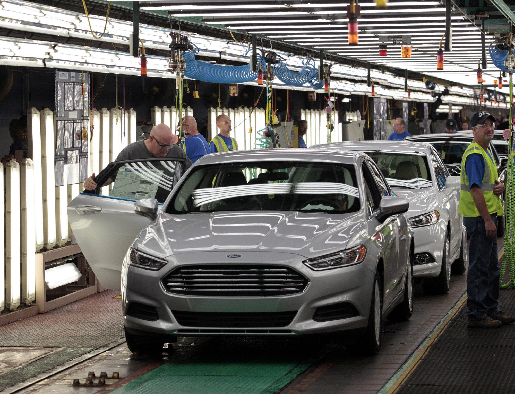 Workers at the Ford plant in Flat Rock, Mich., assemble on 2014 Ford Fusions, one of the vehicles helping to bring new life to U.S. fleet sales.