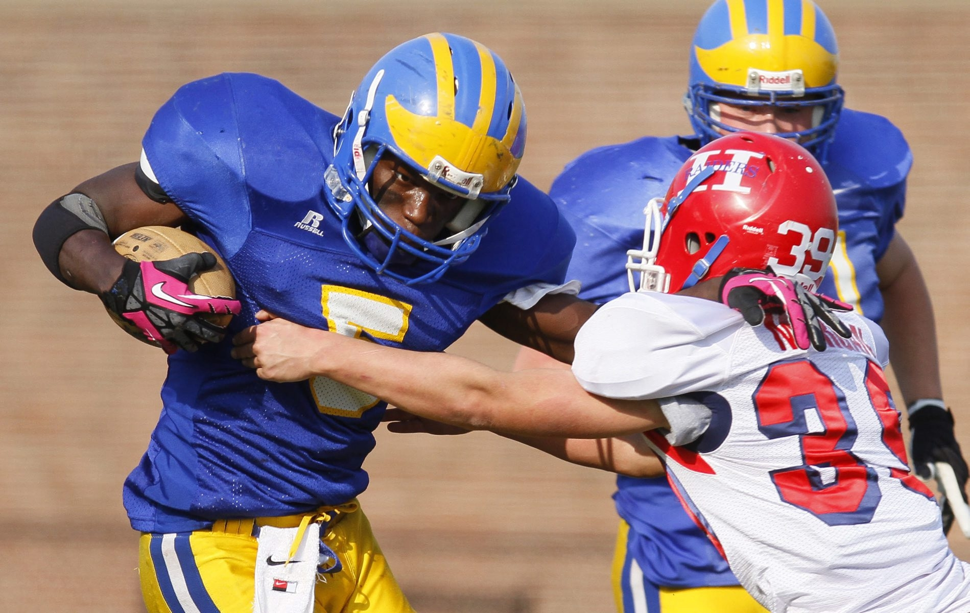 Brandon Thomas (5) is coming off a 1,200-yard season and is among 11 returnees for Cleveland Hill.