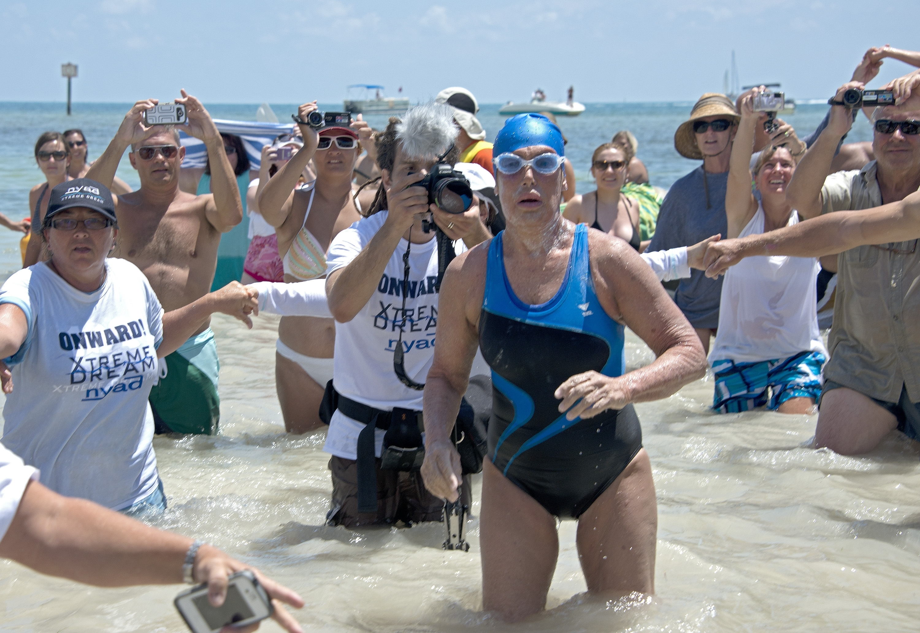 Diana Nyad emerges from the water after completing a 110-mile swim from Cuba to Key West, Fla. (AP photo)